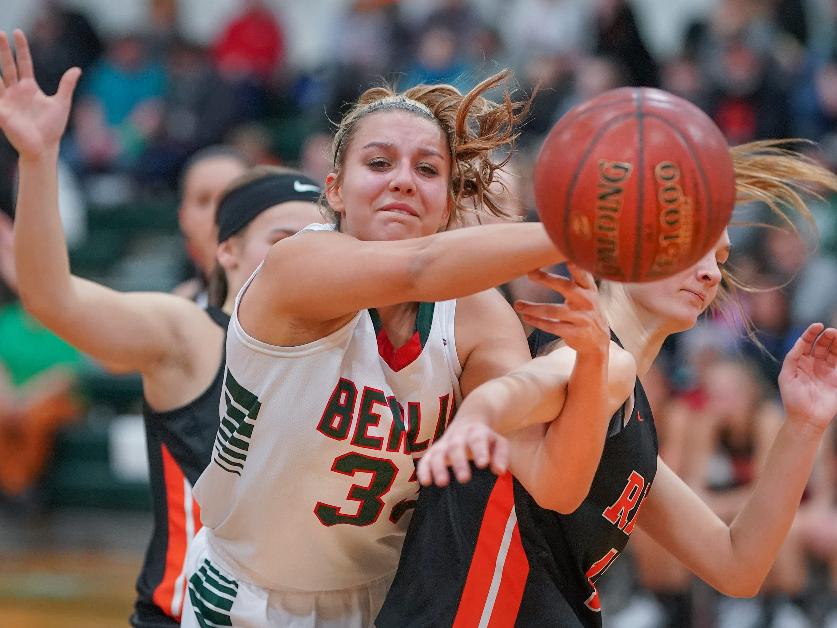 Madalyn Naparalla (33) of Berlin gets a pass away while in double coverage. The Berlin Indians hosted the Ripon Tigers in an East Central Conference girls basketball matchup Friday evening, December 21, 2018.