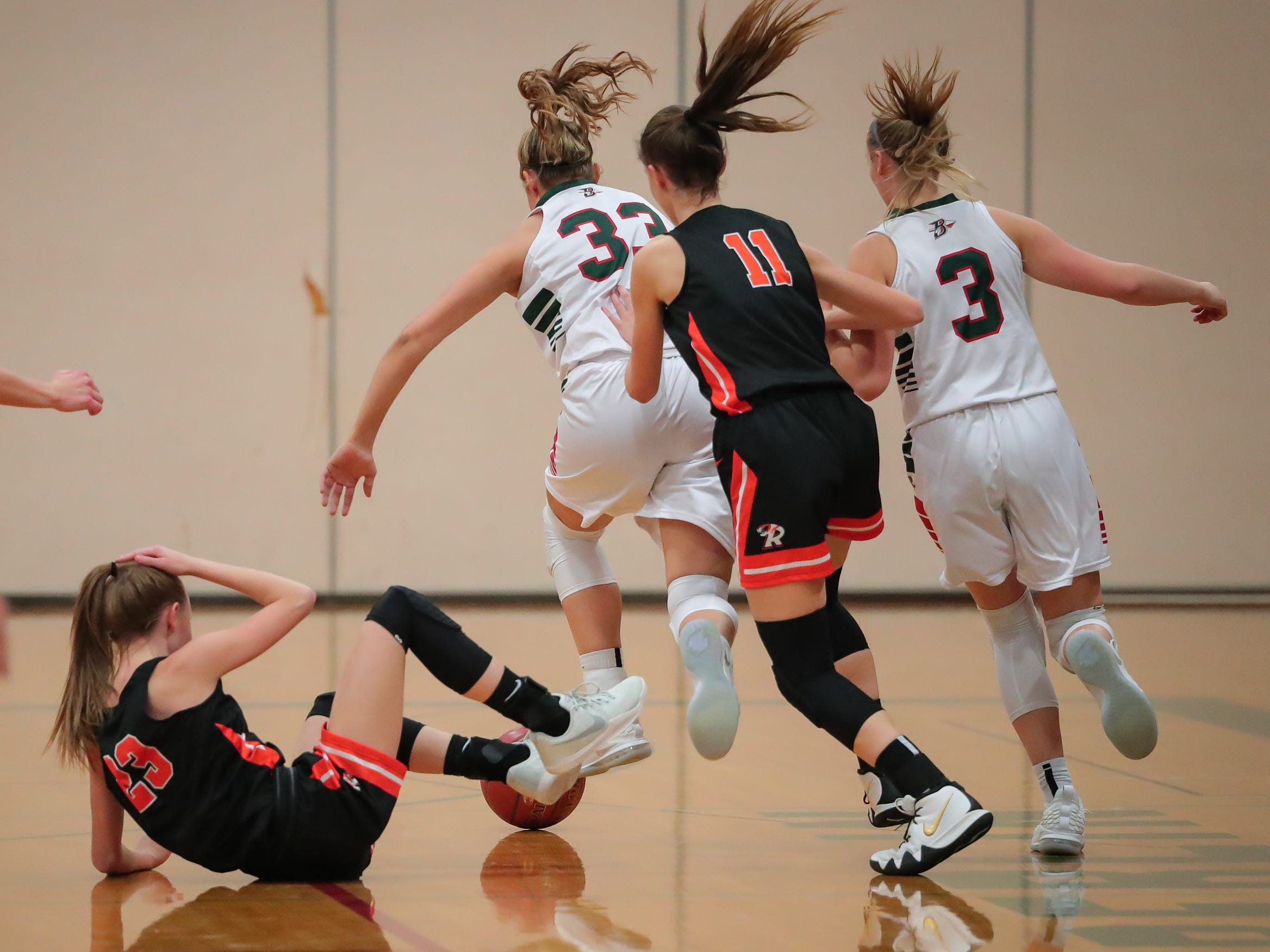 Madalyn Naparalla (33) of Berlin chases a loose ball. The Berlin Indians hosted the Ripon Tigers in an East Central Conference girls basketball matchup Friday evening, December 21, 2018.