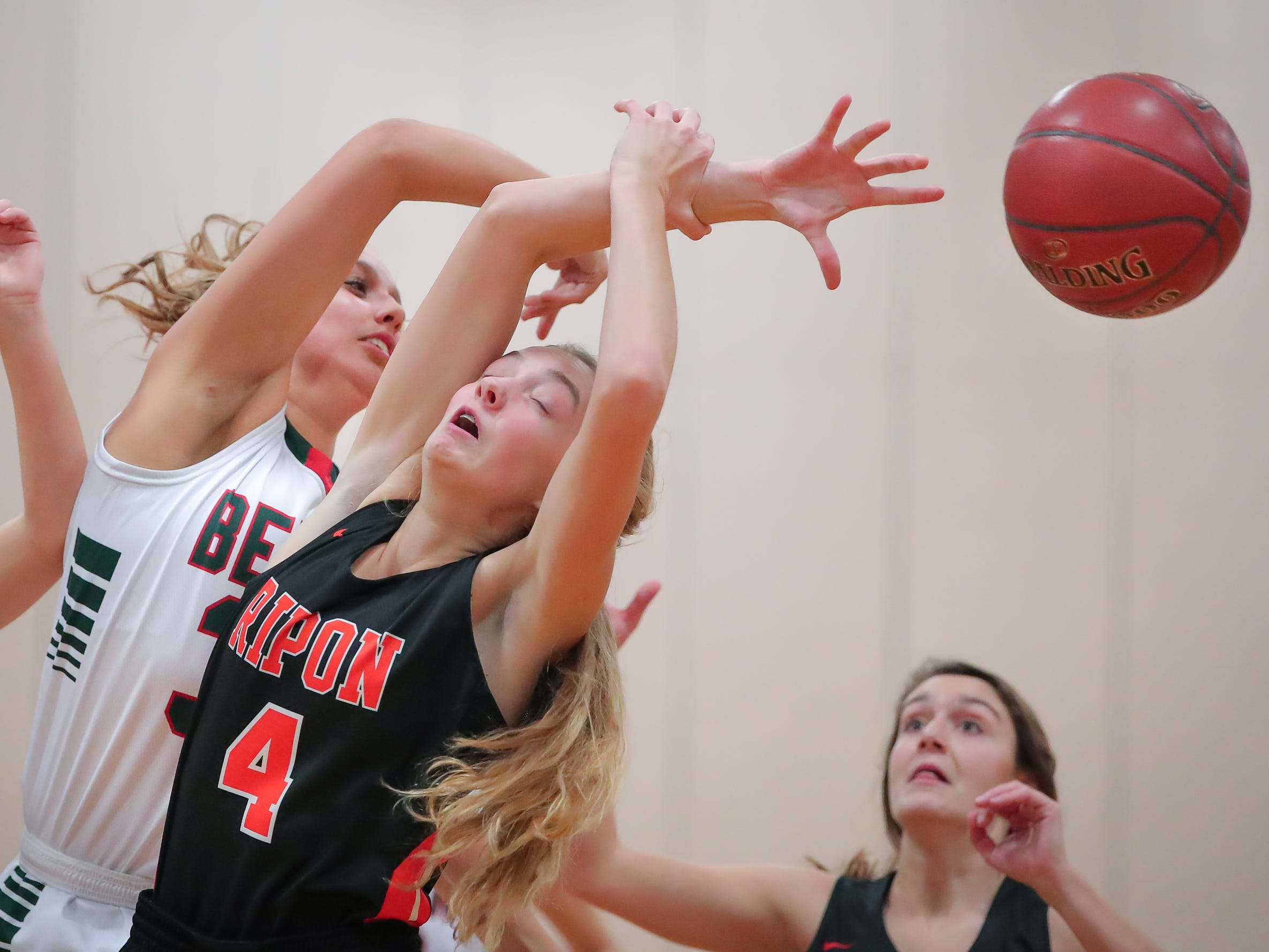 Madalyn Naparalla (33) of Berlin and Elle Lewis (4) of Ripon battle for the ball. The Berlin Indians hosted the Ripon Tigers in an East Central Conference girls basketball matchup Friday evening, December 21, 2018.
