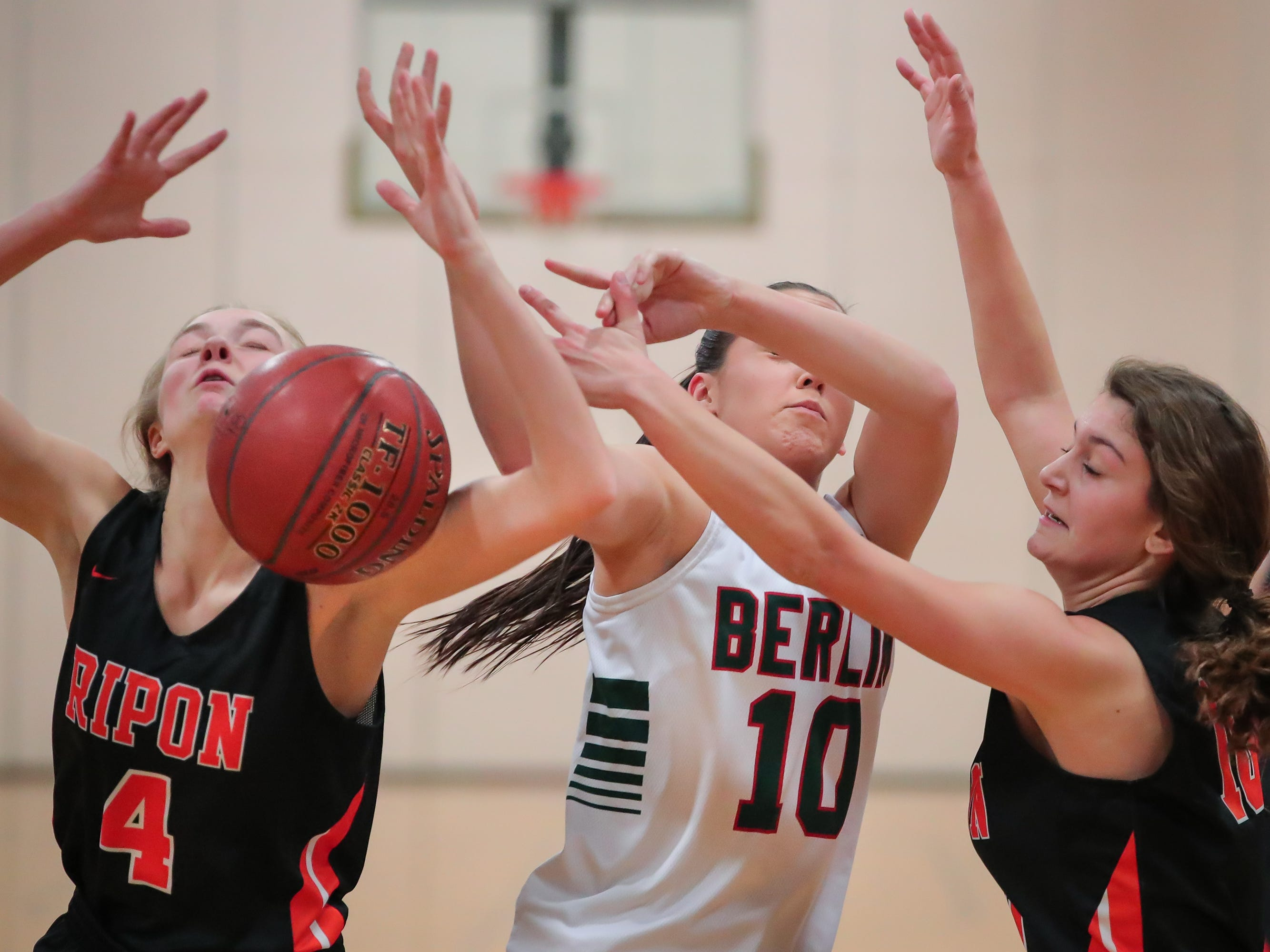 Elle Lewis (4) of Ripon and Kara Block (10) of Berlin battle for a rebound. The Berlin Indians hosted the Ripon Tigers in an East Central Conference girls basketball matchup Friday evening, December 21, 2018.