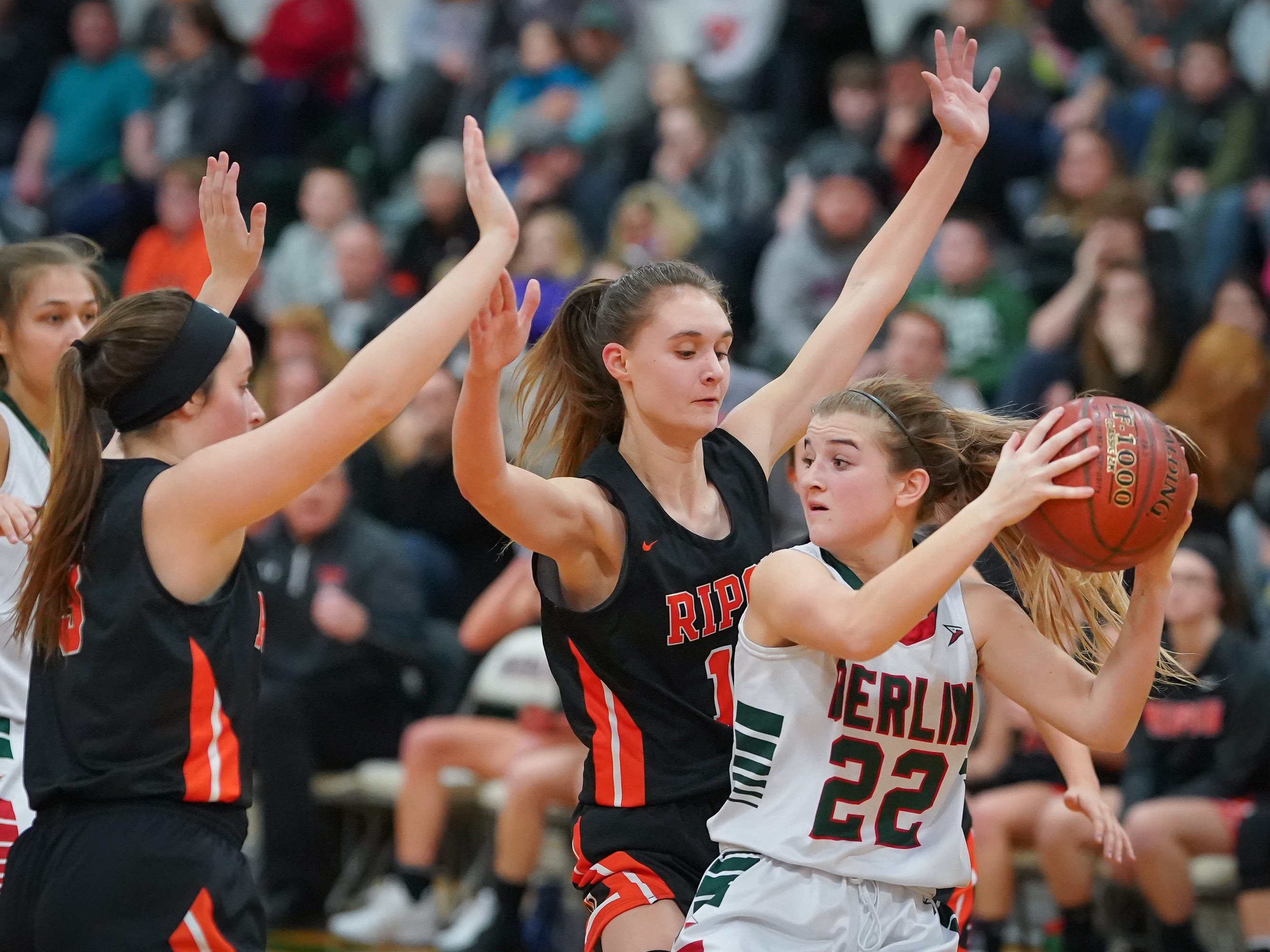 Mari Beltran (22) of Berlin tries to pass the ball while covered by Alexa Miller (11) of Ripon. The Berlin Indians hosted the Ripon Tigers in an East Central Conference girls basketball matchup Friday evening, December 21, 2018.