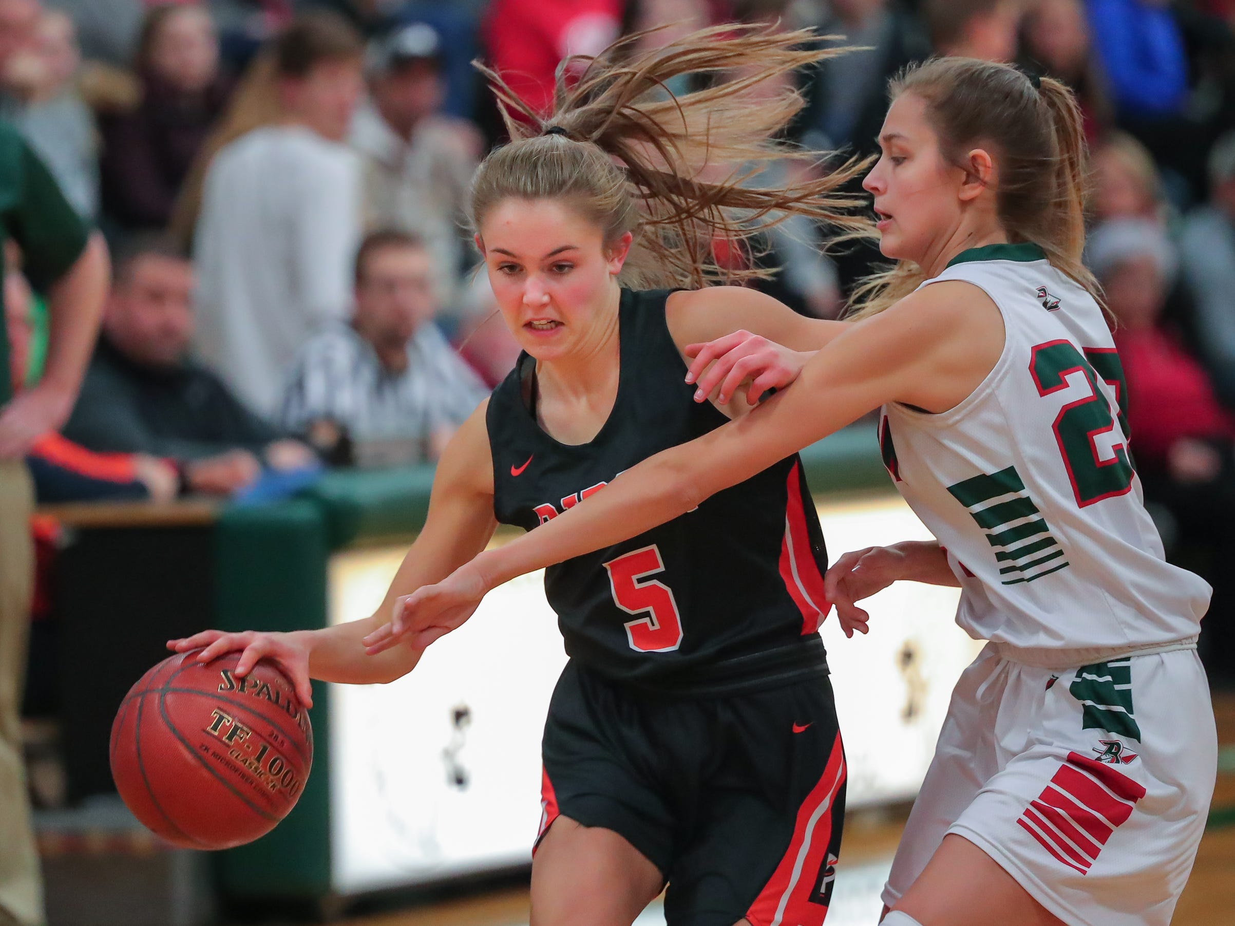 Hadley Neper (5) of Ripon drives around Emily Klawitter (23) of Berlin. The Berlin Indians hosted the Ripon Tigers in an East Central Conference girls basketball matchup Friday evening, December 21, 2018.