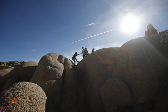Joshua Tree National Park was unattended by any park service personnel on Saturday December 22, 2018 as the budgetary shutdown of the federal government kicked in in California. In this photo people enjoy Skull Rock rock formations.