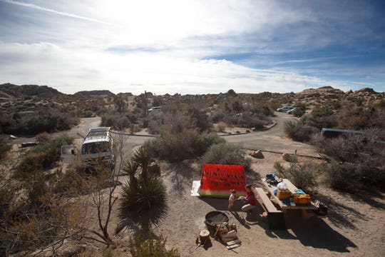 Joshua Tree National Park was unattended by any park service personnel on Saturday December 22, 2018 as the budgetary shutdown of the federal government kicked in in California. In this photo, Los Angeles residents Gustavo and Shelly Huber set up camp with their daughter, Zia. The couple, who said they were married in Joshua Tree about six years ago, did first-come, first-serve camping with their Volkswagen van and a tent at Jumbo Rocks Campground.