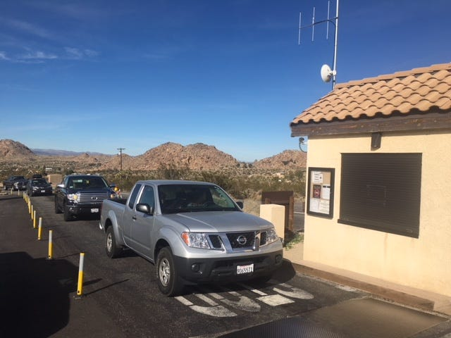 The west entry gate at Joshua Tree National Park was not staffed on Saturday morning, allowing park visitors to enter without paying the $30-oer-vehicle fee.
