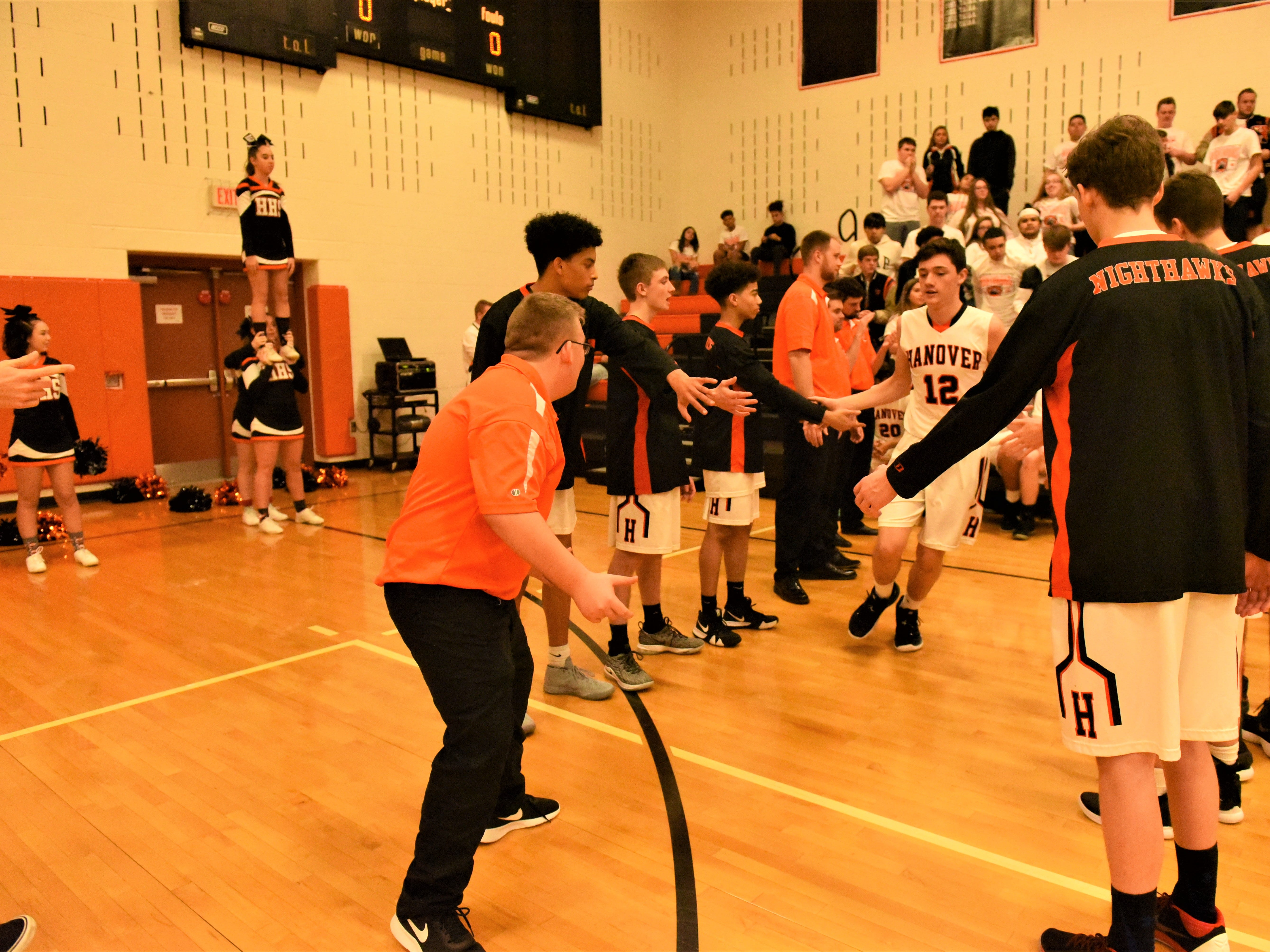 Kyle Garman is greeted by his teammates at the start of the game. Fairfield High School lost at Hanover High School on Dec. 21, 57 to 43.