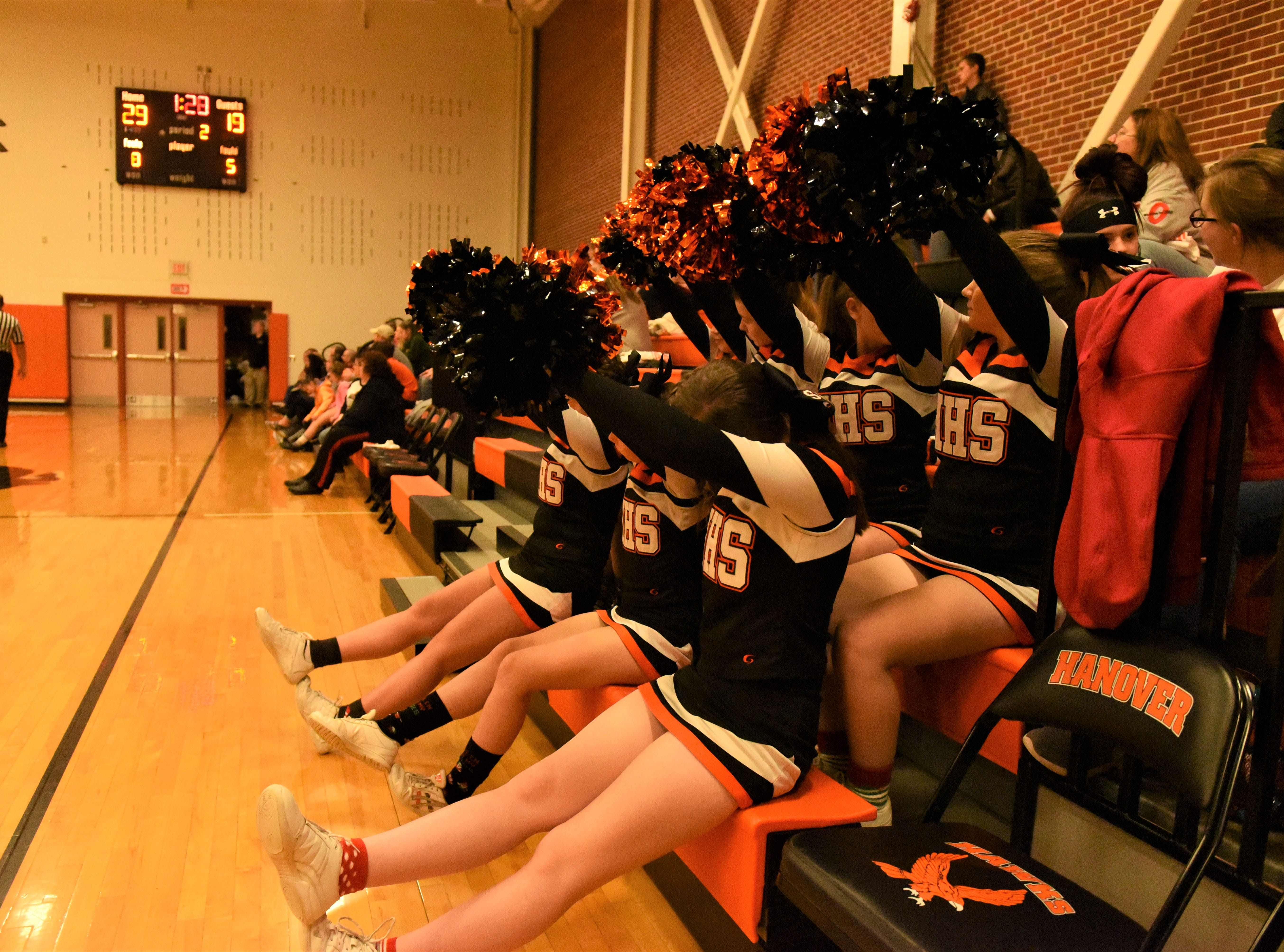 The Hanover cheerleaders are waiting to see if the free throw goes in. Fairfield High School lost at Hanover High School on Dec. 21, 57 to 43.
