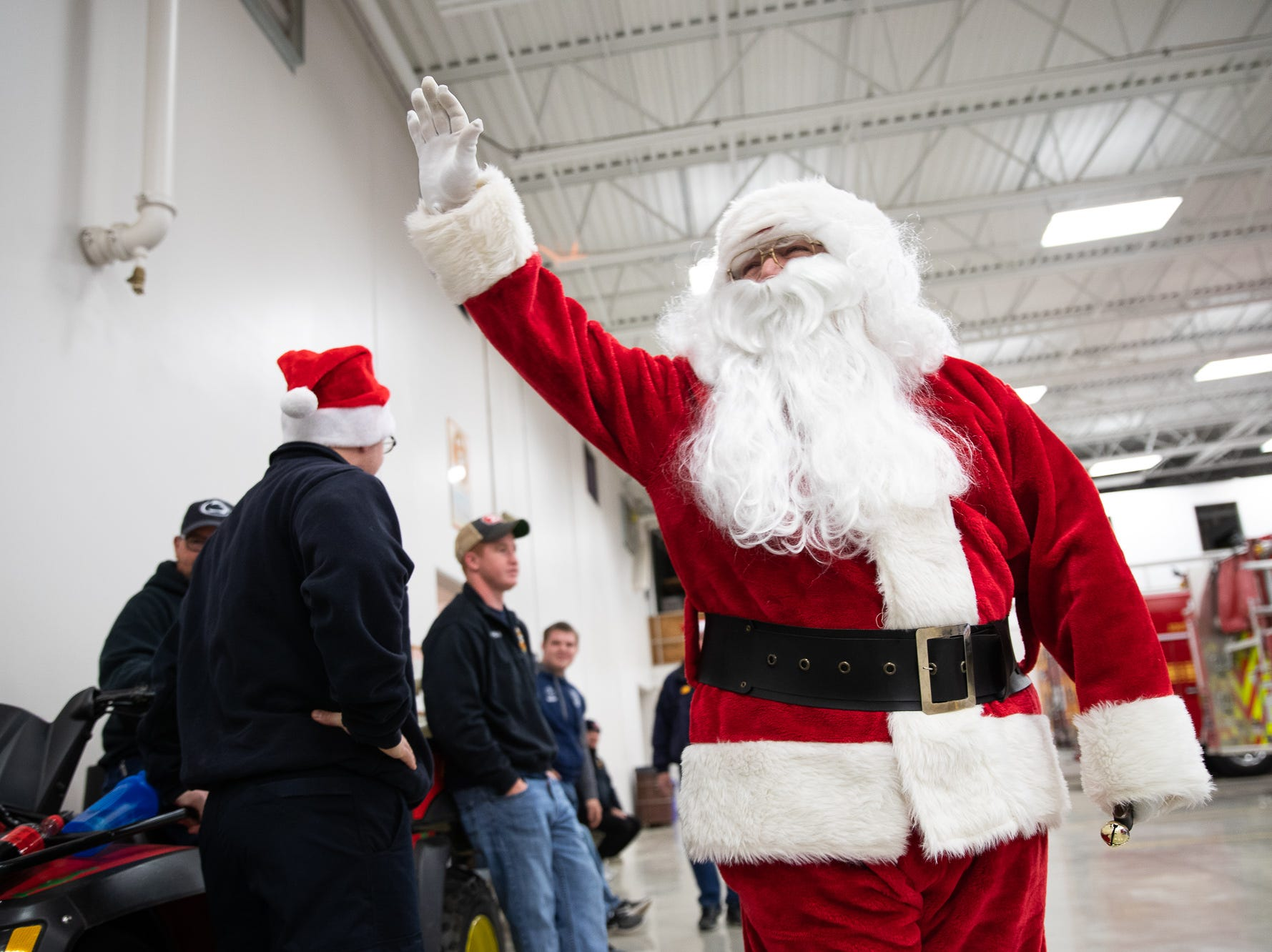 Santa, played by firefighter Wayne Reid, arrives to the Southeastern Adams County Volunteer Emergency Services fire station during the S.A.V.E.S Project Santa, Saturday, Dec. 22, 2018, in McSherrystown Borough. The S.A.V.E.S Project Santa donated food, toys, and clothing to 12 local families in need.