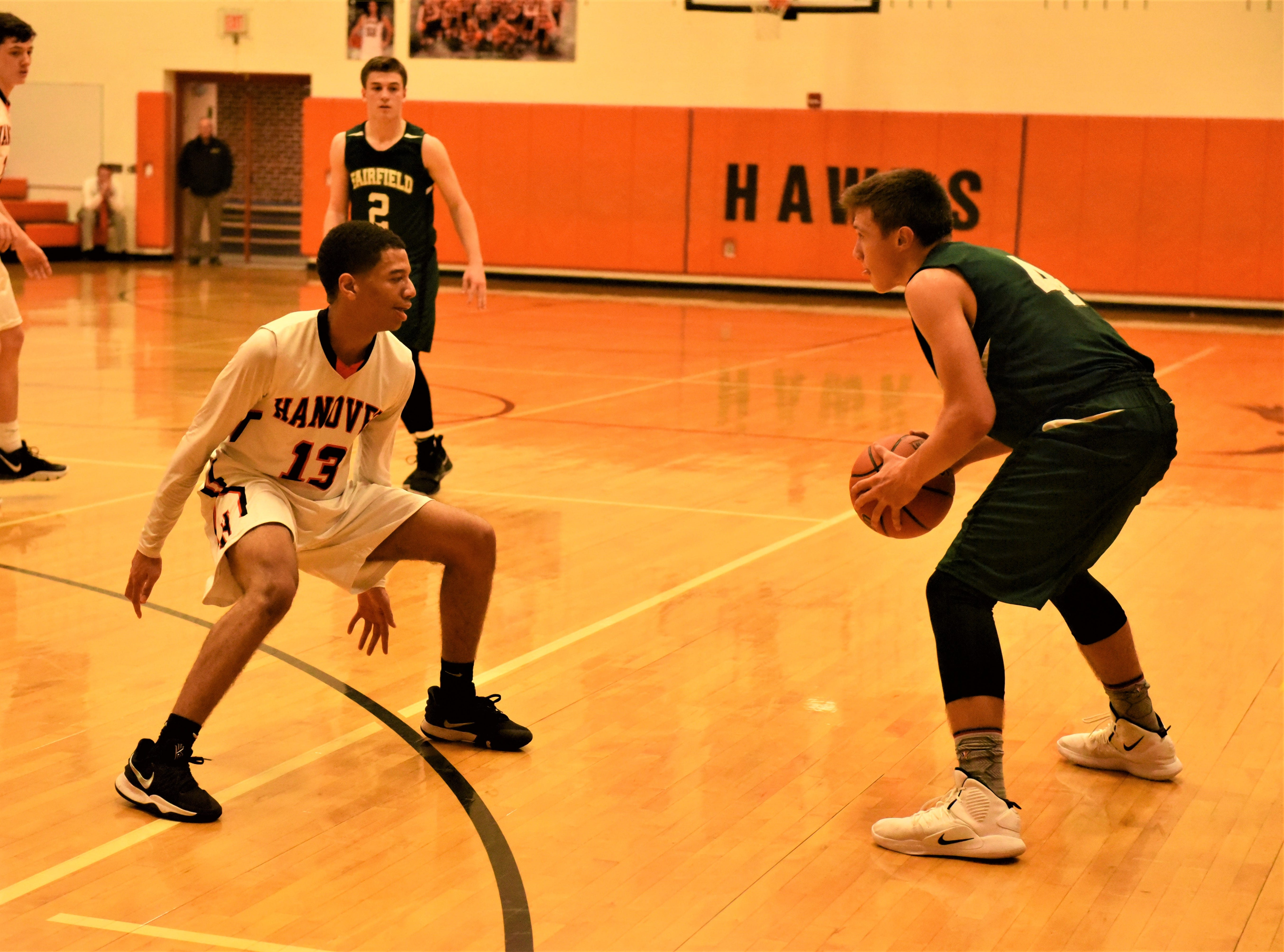 Kwame Myers plays defense on Peyton Stadler. Fairfield High School lost at Hanover High School on Dec. 21, 57 to 43.