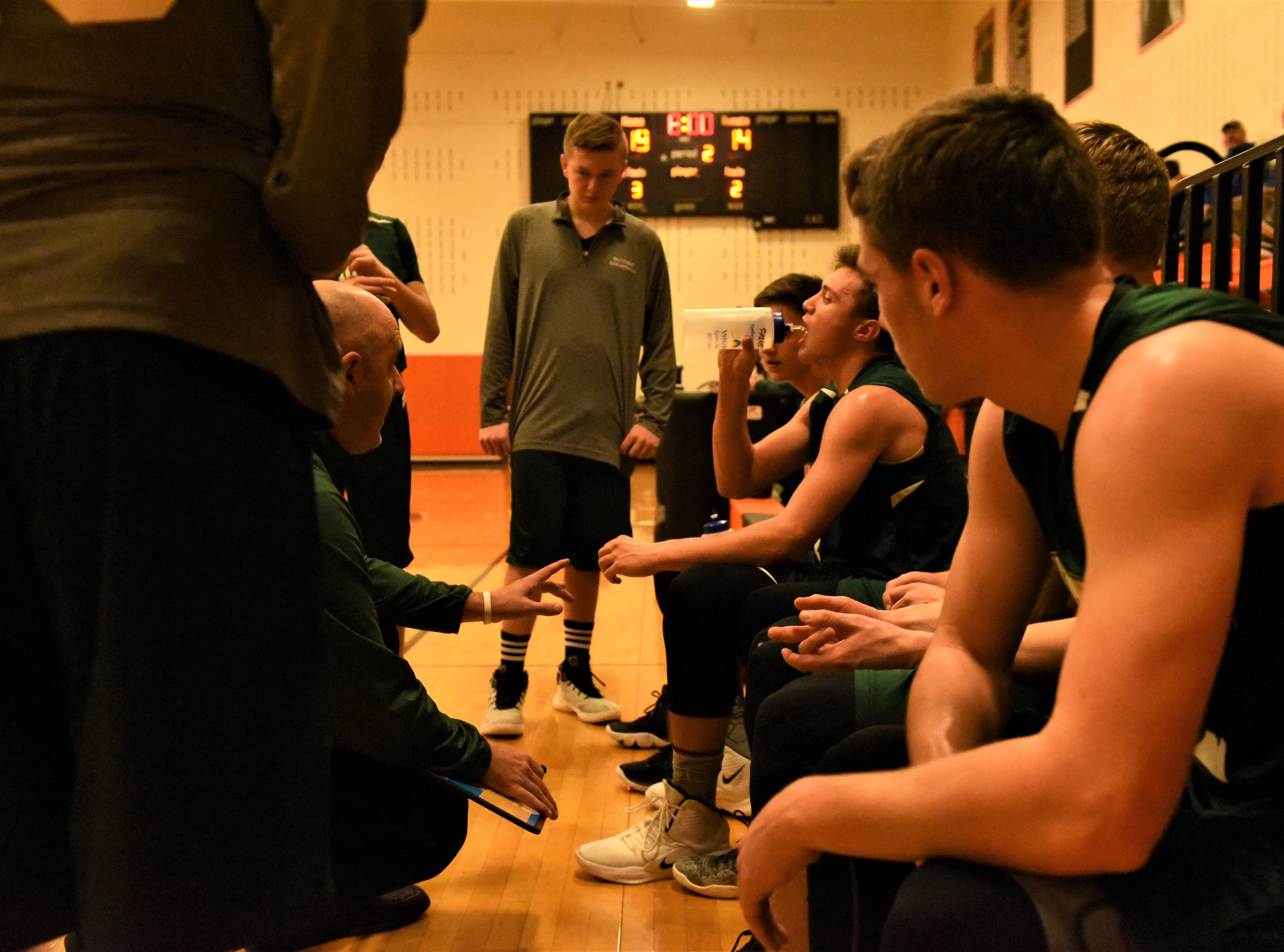 The Fairfield coach talks to the team at the end of the first half. Fairfield High School lost at Hanover High School on Dec. 21, 57 to 43.