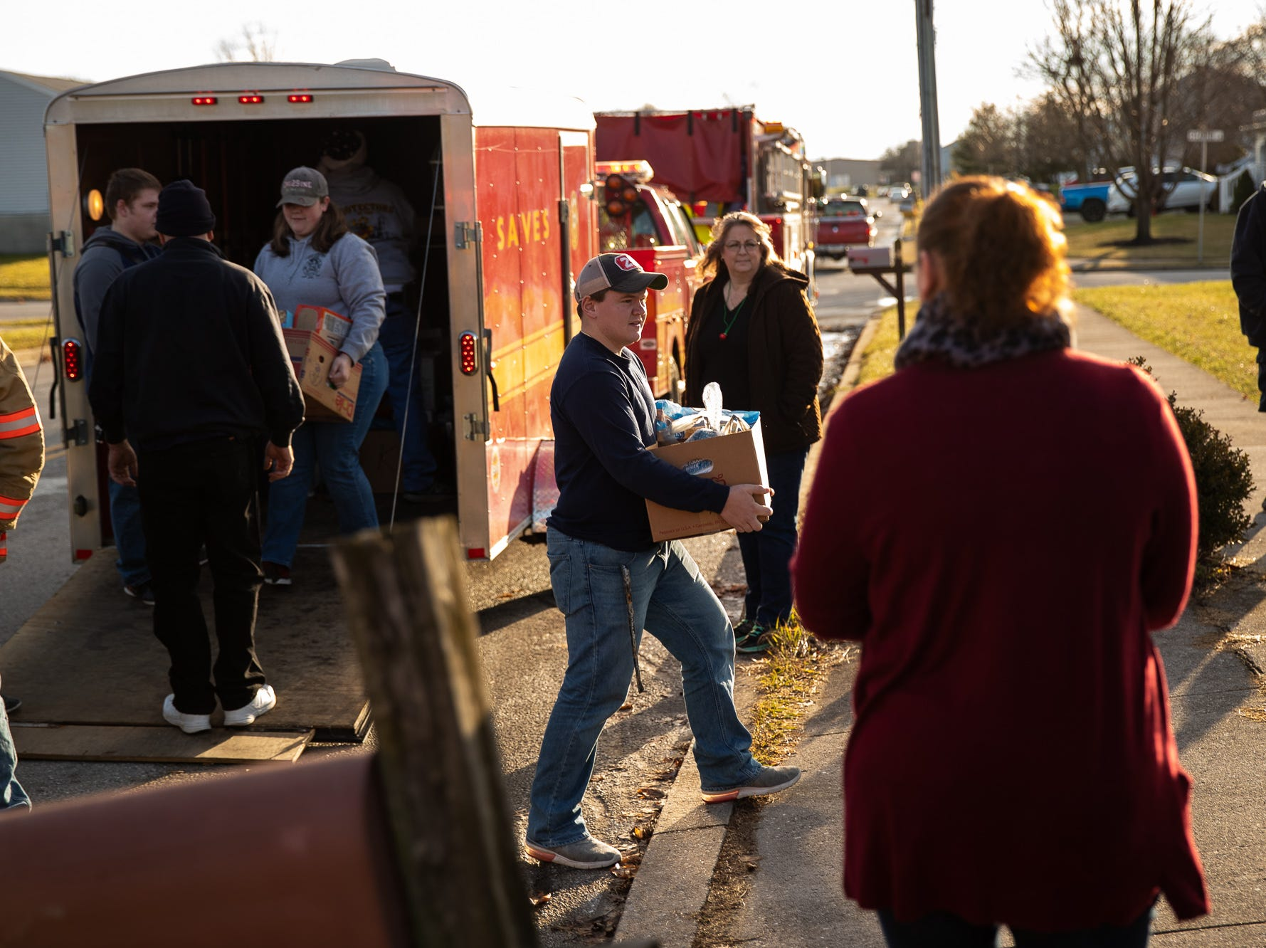 Firefighter Brady Cromer carries presents during the S.A.V.E.S Project Santa, Saturday, Dec. 22, 2018, in McSherrystown Borough. The S.A.V.E.S Project Santa donated food, toys, and clothing to 12 local families in need.