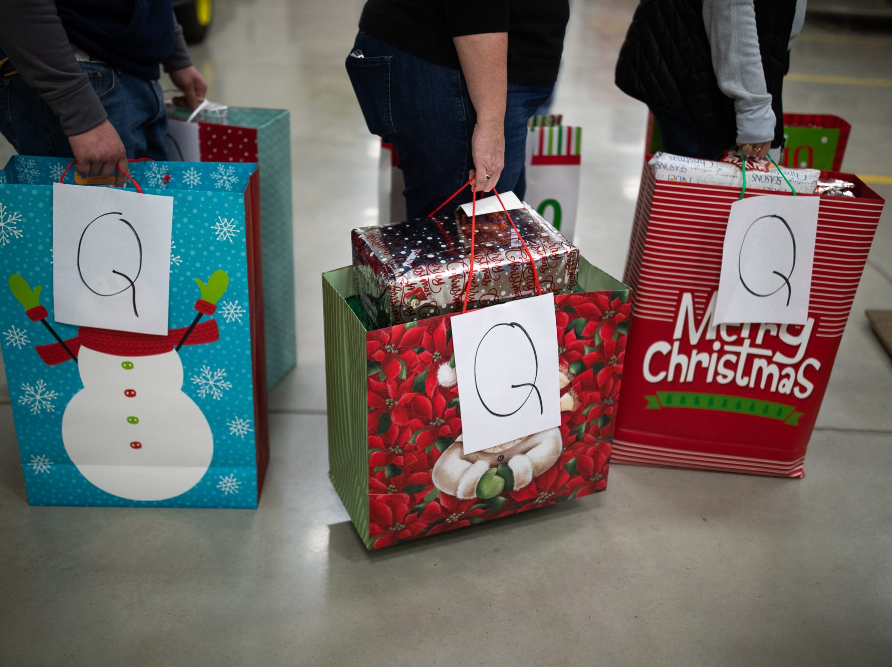 Volunteers load presents at the Southeastern Adams County Volunteer Emergency Services fire station during the S.A.V.E.S Project Santa, Saturday, Dec. 22, 2018, in McSherrystown Borough. The S.A.V.E.S Project Santa donated food, toys, and clothing to 12 local families in need.