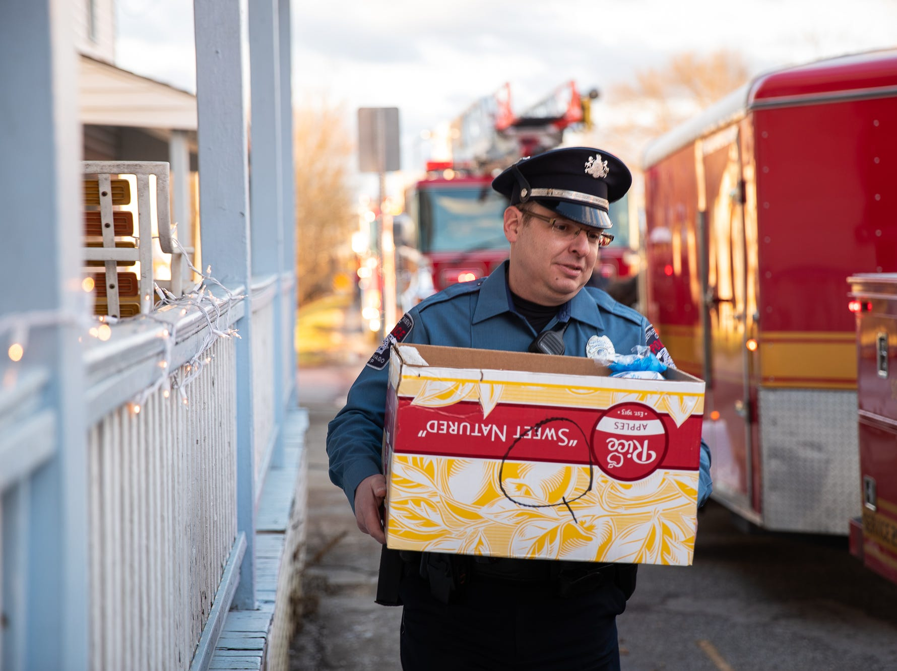 A Conewago Township police officer helps carry presents during the S.A.V.E.S Project Santa, Saturday, Dec. 22, 2018, in McSherrystown Borough. The S.A.V.E.S Project Santa donated food, toys, and clothing to 12 local families in need.