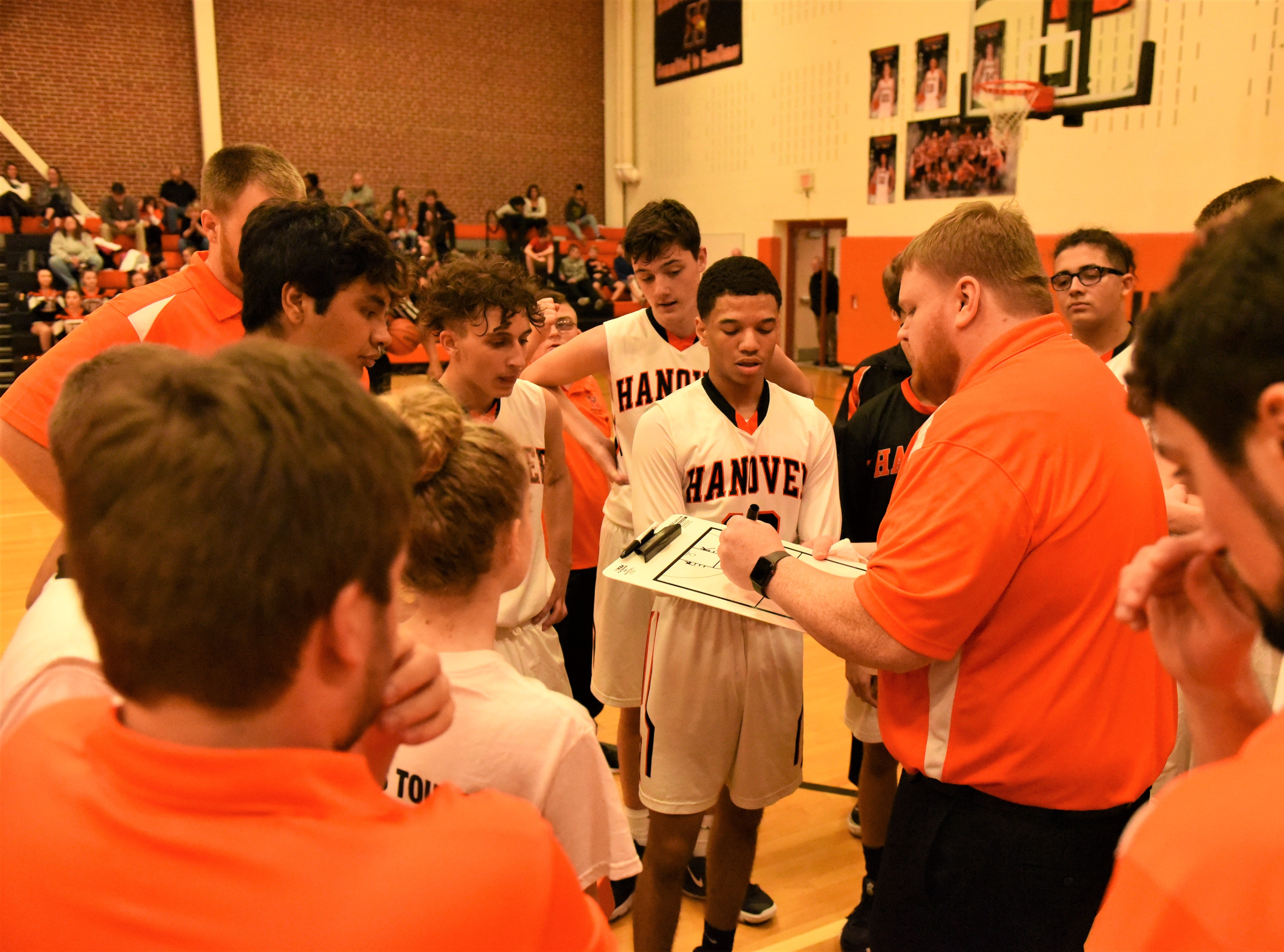 Coach Gibbon talks to the team during a time out. Fairfield High School lost at Hanover High School on Dec. 21, 57 to 43.