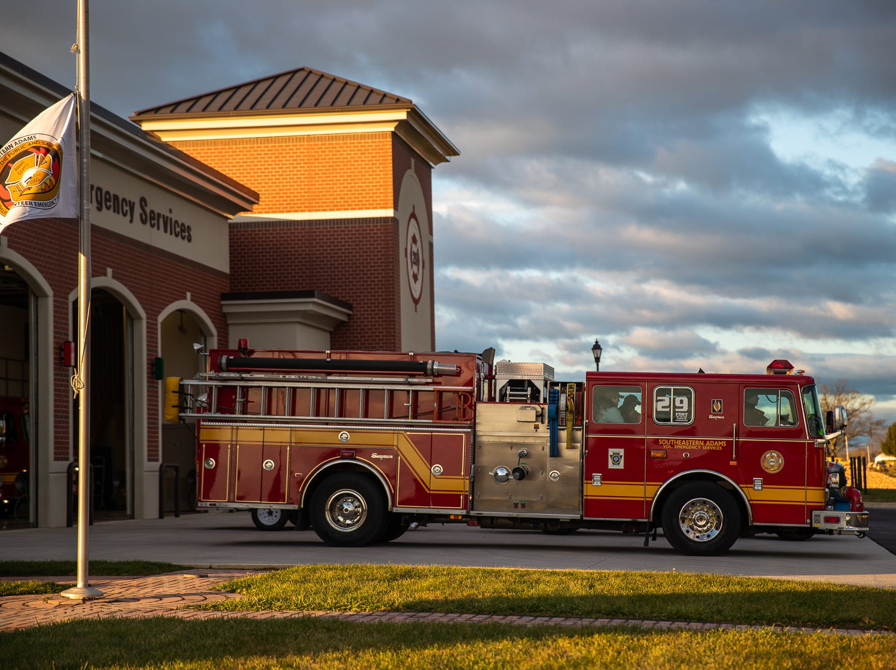 Engine-Tanker 29 prepares to roll out at the Southeastern Adams County Volunteer Emergency Services fire station during the S.A.V.E.S Project Santa, Saturday, Dec. 22, 2018, in McSherrystown Borough. The S.A.V.E.S Project Santa donated food, toys, and clothing to 12 local families in need.