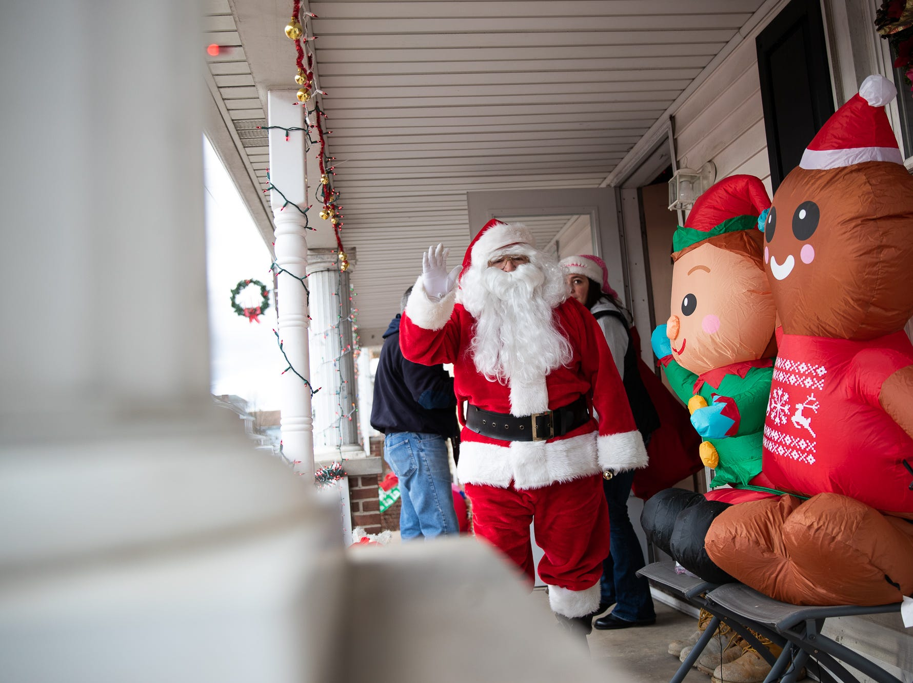 Santa leaves a house during the S.A.V.E.S Project Santa, Saturday, Dec. 22, 2018, in McSherrystown Borough. The S.A.V.E.S Project Santa donated food, toys, and clothing to 12 local families in need.