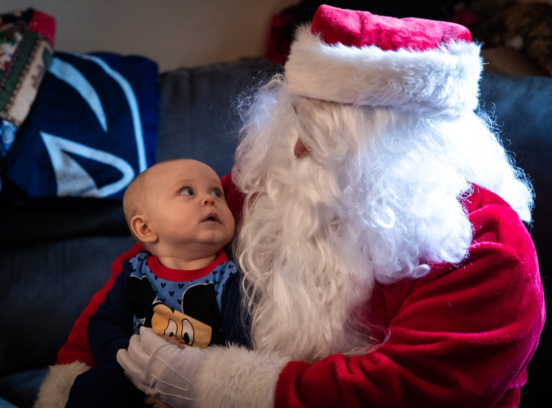 7-month-old Heath reacts to Santa, played by firefighter Wayne Reid, during the S.A.V.E.S Project Santa, Saturday, Dec. 22, 2018, in McSherrystown Borough. The S.A.V.E.S Project Santa donated food, toys, and clothing to 12 local families in need.