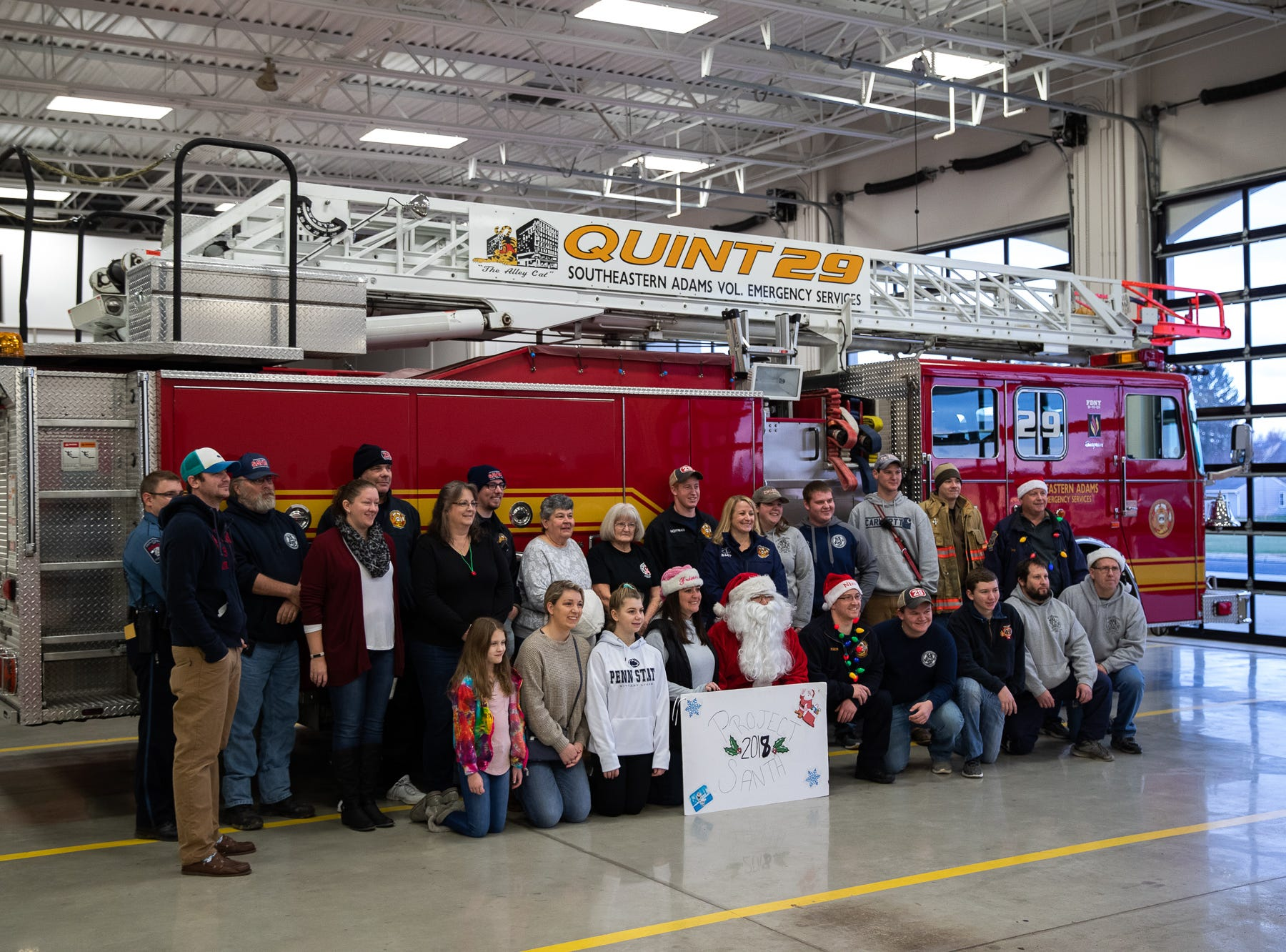 Volunteers pose with Santa, played by firefighter Wayne Reid, at the Southeastern Adams County Volunteer Emergency Services fire station during the S.A.V.E.S Project Santa, Saturday, Dec. 22, 2018, in McSherrystown Borough. The S.A.V.E.S Project Santa donated food, toys, and clothing to 12 local families in need.