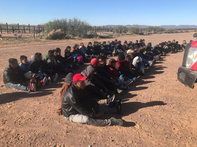 A border patrol photo of a large group of suspected undocumented Central American migrants found near the border this week.