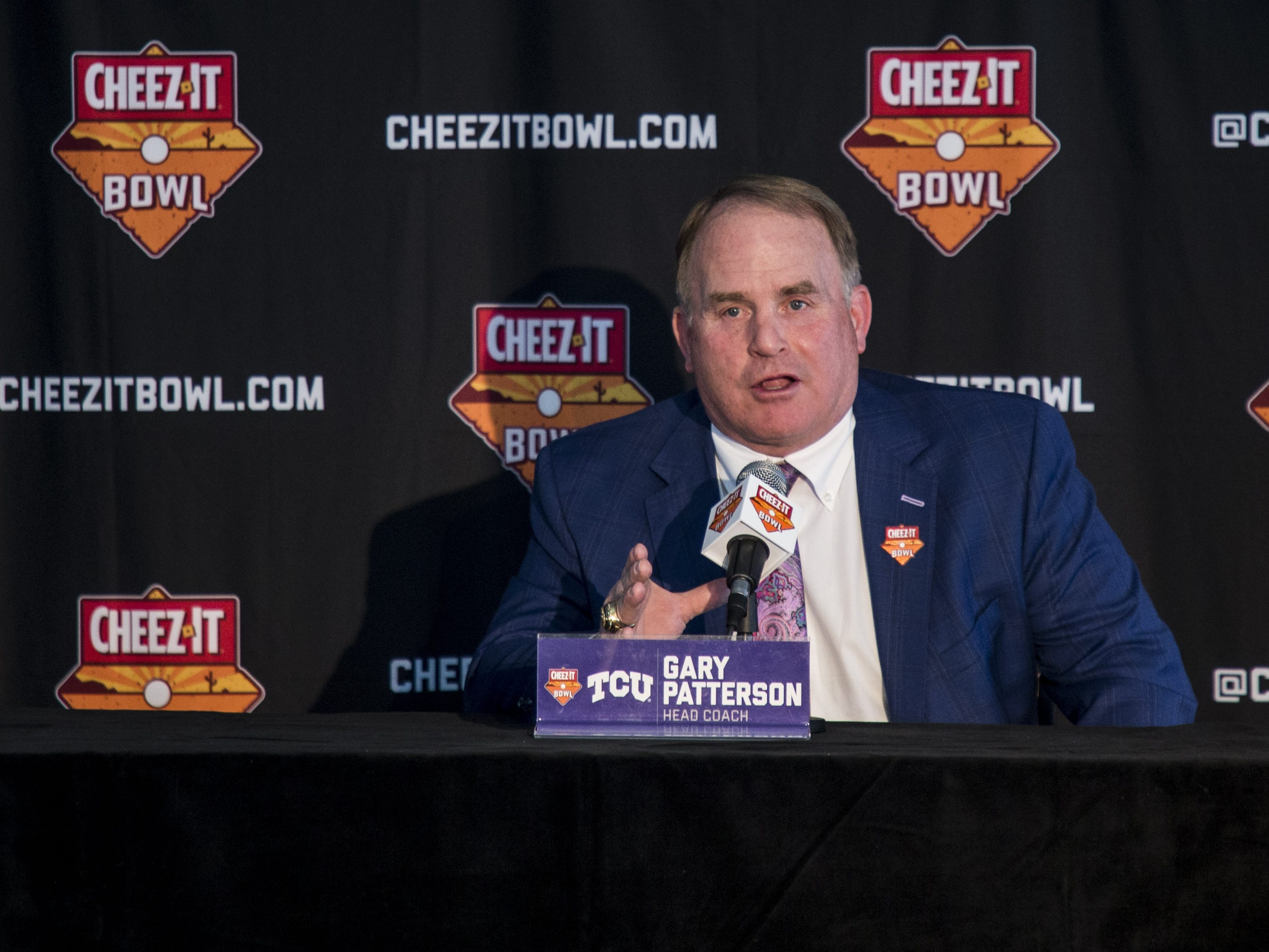 TCU head coach Greg Patterson speaks during a press conference after arriving at Sky Harbor International Airport for the Cheez-It Bowl on Saturday, Dec. 22, 2018, in Phoenix.