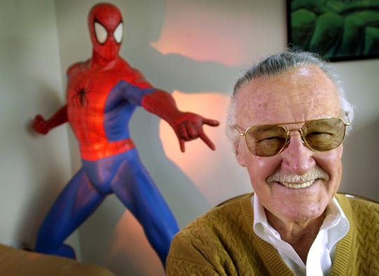 In this April 16, 2002, file photo, Stan Lee smiles during a photo session in his office in Santa Monica, California.