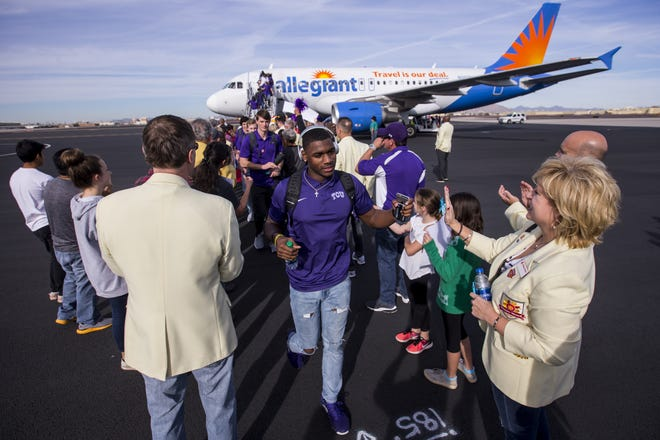 TCU players arrive at Sky Harbor International Airport for the Cheez-It Bowl on Saturday, Dec. 22, 2018, in Phoenix.