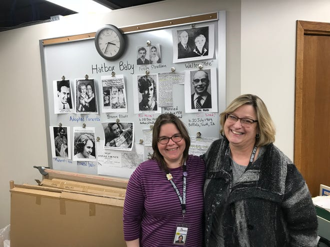 Davenport Public Library researchers Cristina Amador-Perez (left) and Karen O'Connor along with other colleagues built a war board as they dove into the Hatbox Baby story. Their work turned up a a vital clue in the case.
