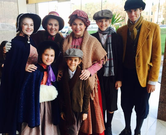 "Some of the cast of Southwest Shakespeare Company's ""A Christmas Carol"" in 2014."
