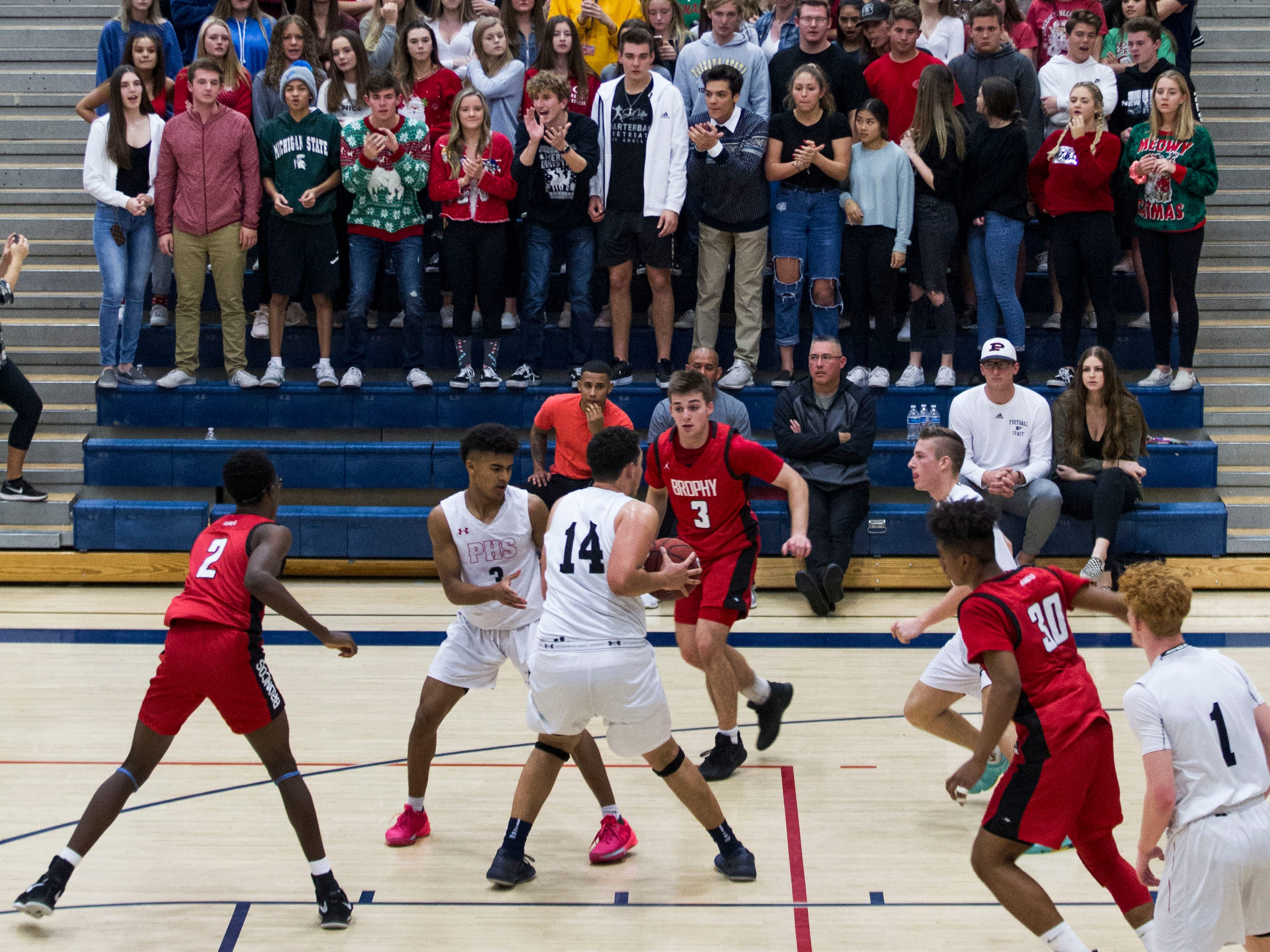 Pinnacle's student body section called the Crazies do their thing during the Brophy game in Phoenix, Friday, Dec. 21, 2018.