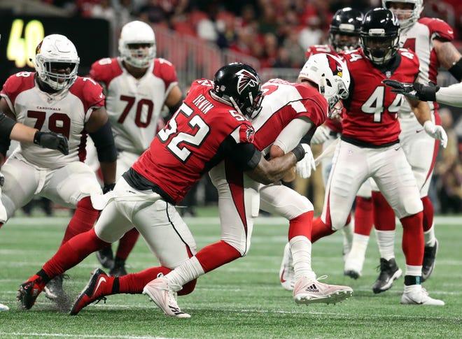 Dec 16, 2018: Atlanta Falcons defensive end Bruce Irvin (52) sacks Arizona Cardinals quarterback Josh Rosen (3) in the third quarter at Mercedes-Benz Stadium.