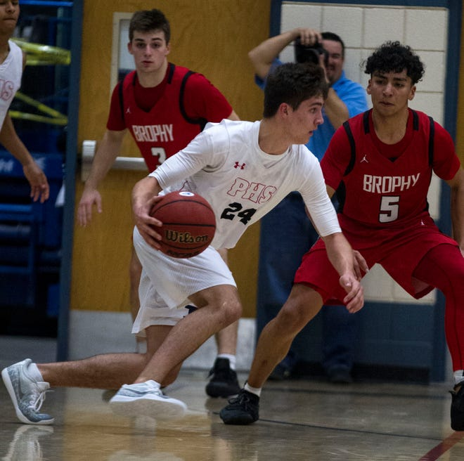 Pinnacle's Trent Brown (24) drives around  Brophy's Jaden Cons(5) during their game in Phoenix, Friday, Dec. 21, 2018.