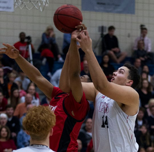 Pinnacle's Tosh Baker (14) fights for rebound with Brophy's  Marques White (20) during their game in Phoenix, Friday, Dec. 21, 2018.