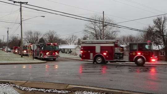 "The Port Clinton Police and Fire Departments organized an ""Operation Bright and Loud"" procession to honor the memory of Linda Hartlaub, a longtime public servant."