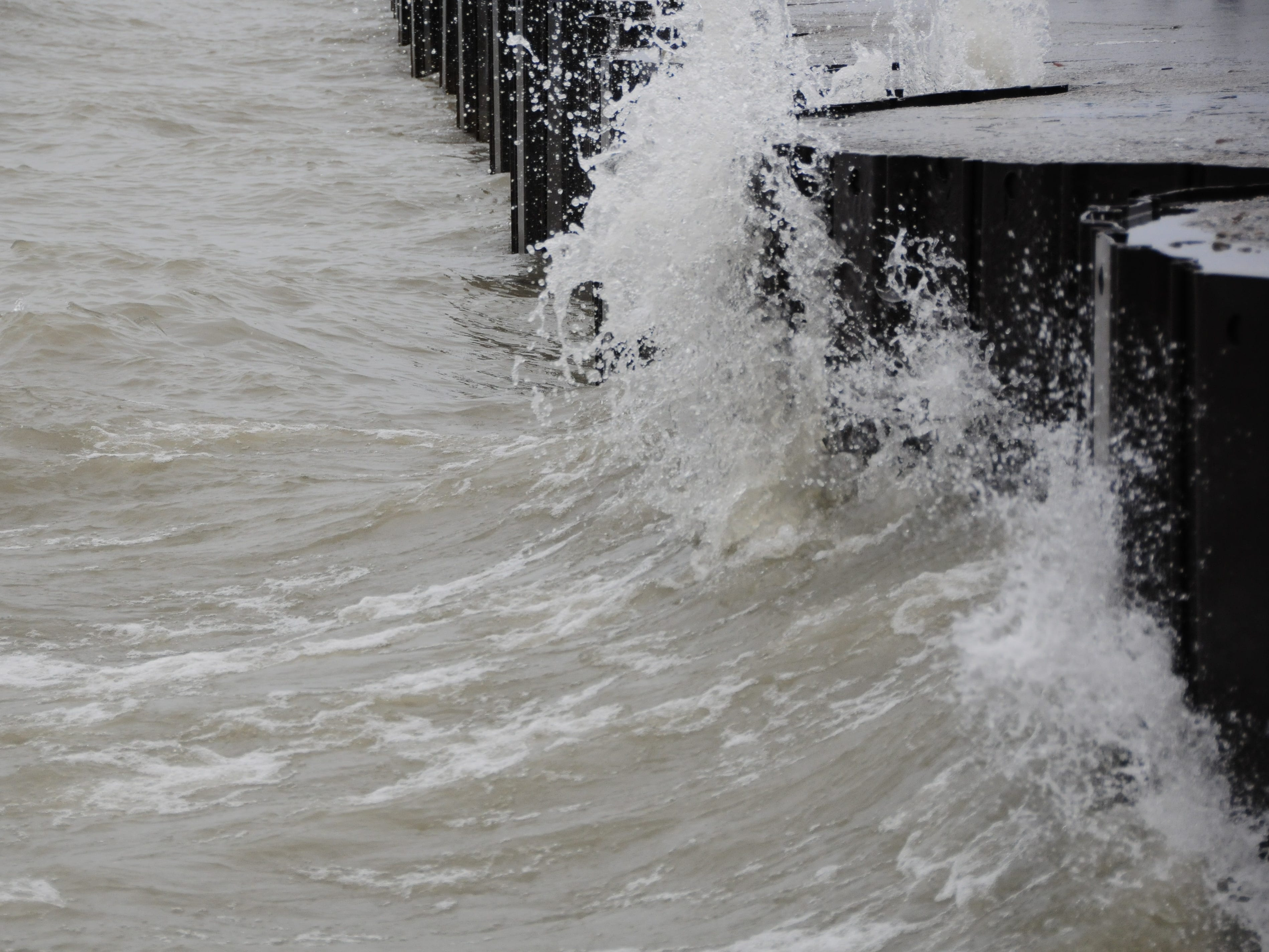 Waves slam into the breakwall at Port Sanilac on Saturday, Dec. 22, 2018.