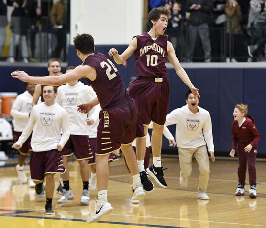Pittsford Mendon's Charlie Bennett, right, and Nate Strauf celebrate their win over Pittsford Sutherland during the 18th Annual Rainbow Classic played at the University of Rochester, Friday, Dec. 21, 2018.