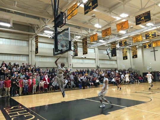McQuaid's Kobe Long goes up for a layup