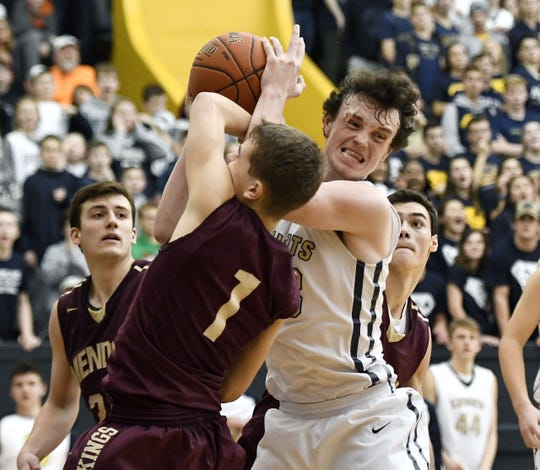 Pittsford Sutherland's Kevin Ryan, right, wrestles a rebound away from Pittsford Mendon's Jacob Shadders during the 18th Annual Rainbow Classic played at the University of Rochester, Friday, Dec. 21, 2018.