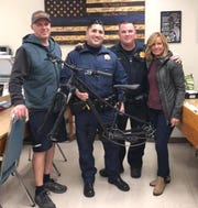 Mitch and Angie James, far left and far right, pick up a bicycle frame that was stolen from the Redding bike shop either late Tuesday or early Wednesday. Also shown are CHP officers Javier Garcia, second from left, and Jarred Wallace who helped recover the stolen property.
