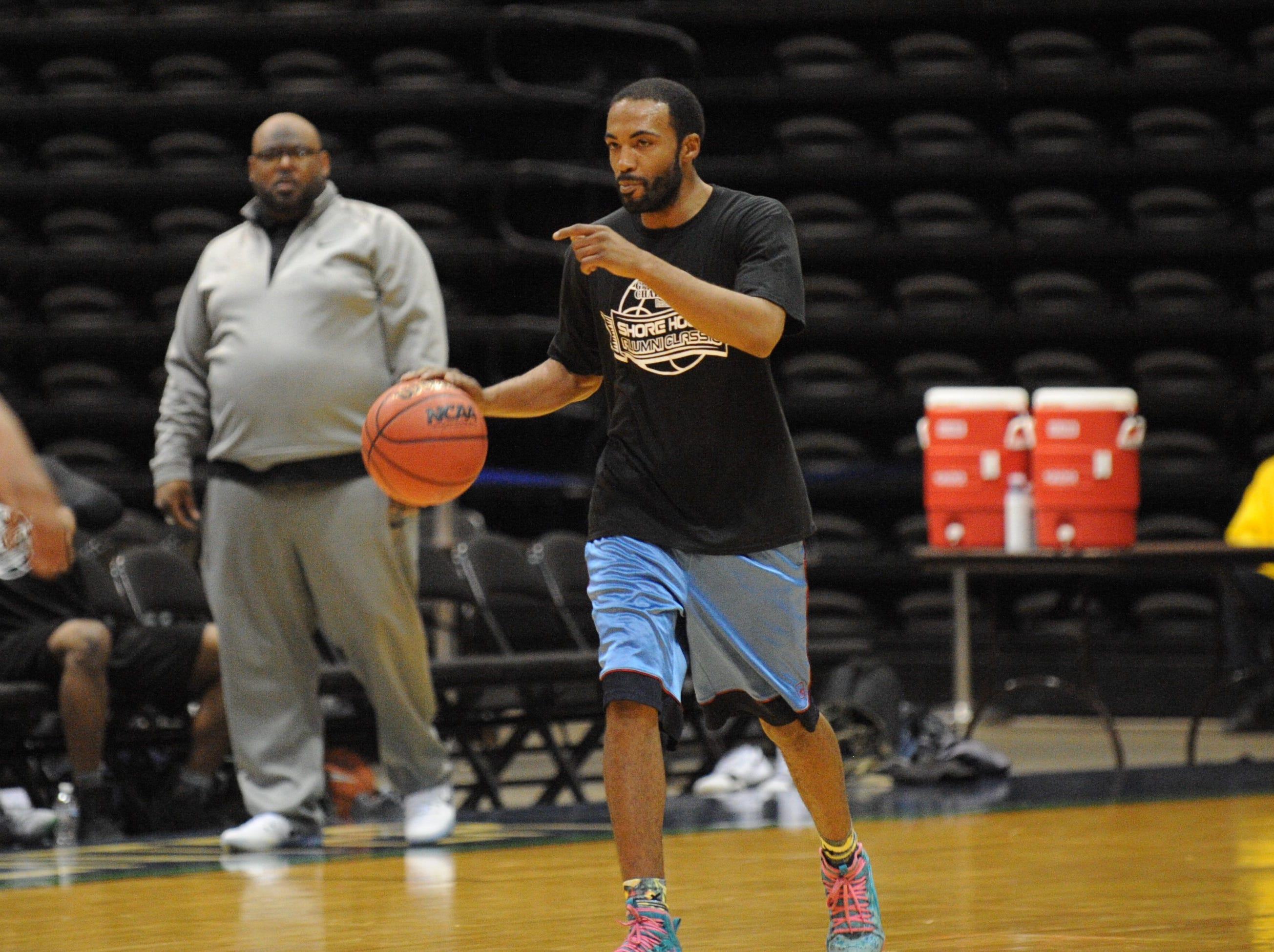 A member of the 2001/2008 Snow Hill basketball team takes the ball down the court at the first ever Shore Hoops Alumni Classic on Saturday, Dec. 22, 2018.
