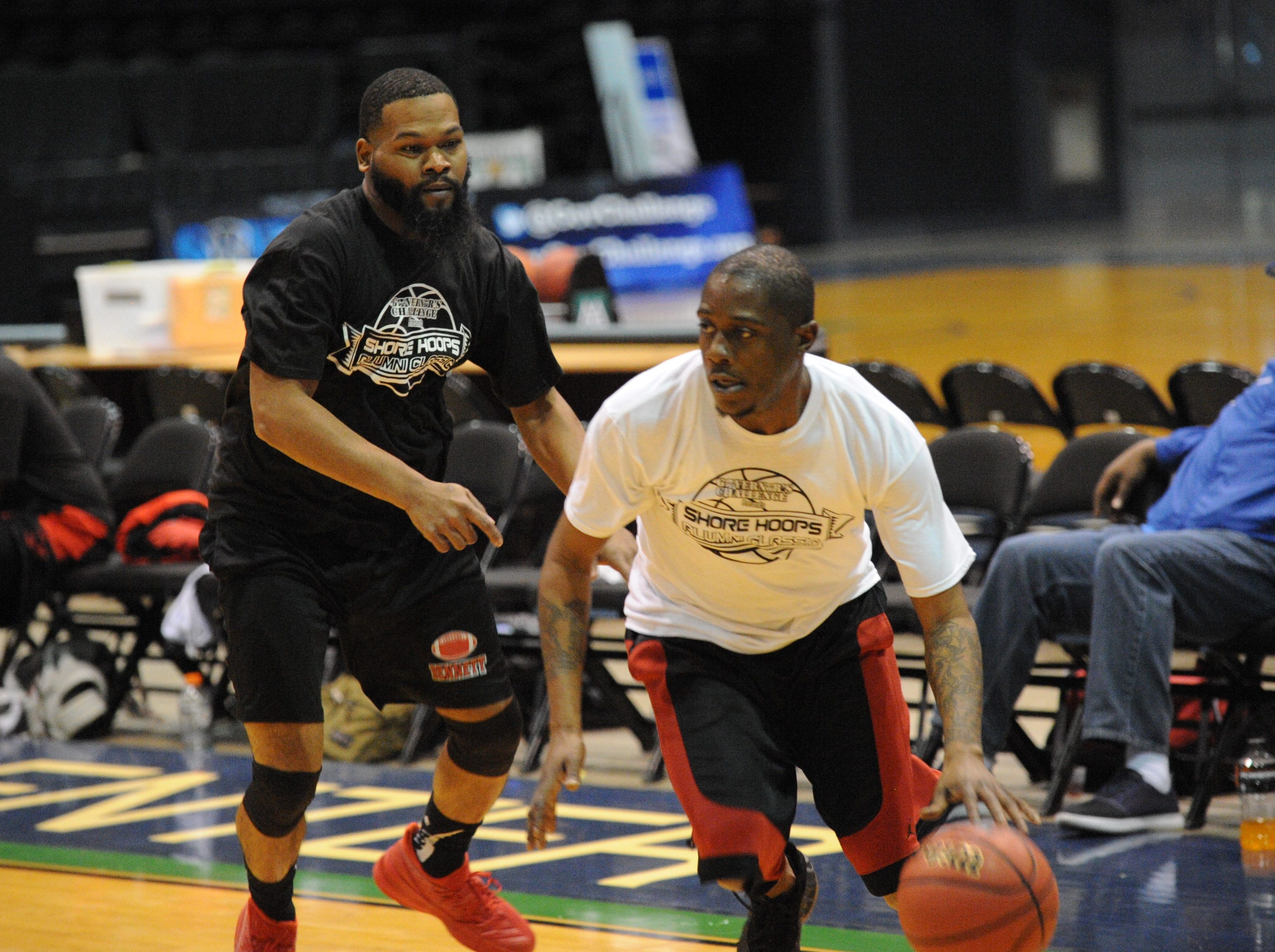 A member of the 2003 James M. Bennett basketball team takes the ball up court at the first ever Shore Hoops Alumni Classic on Saturday, Dec. 22, 2018.