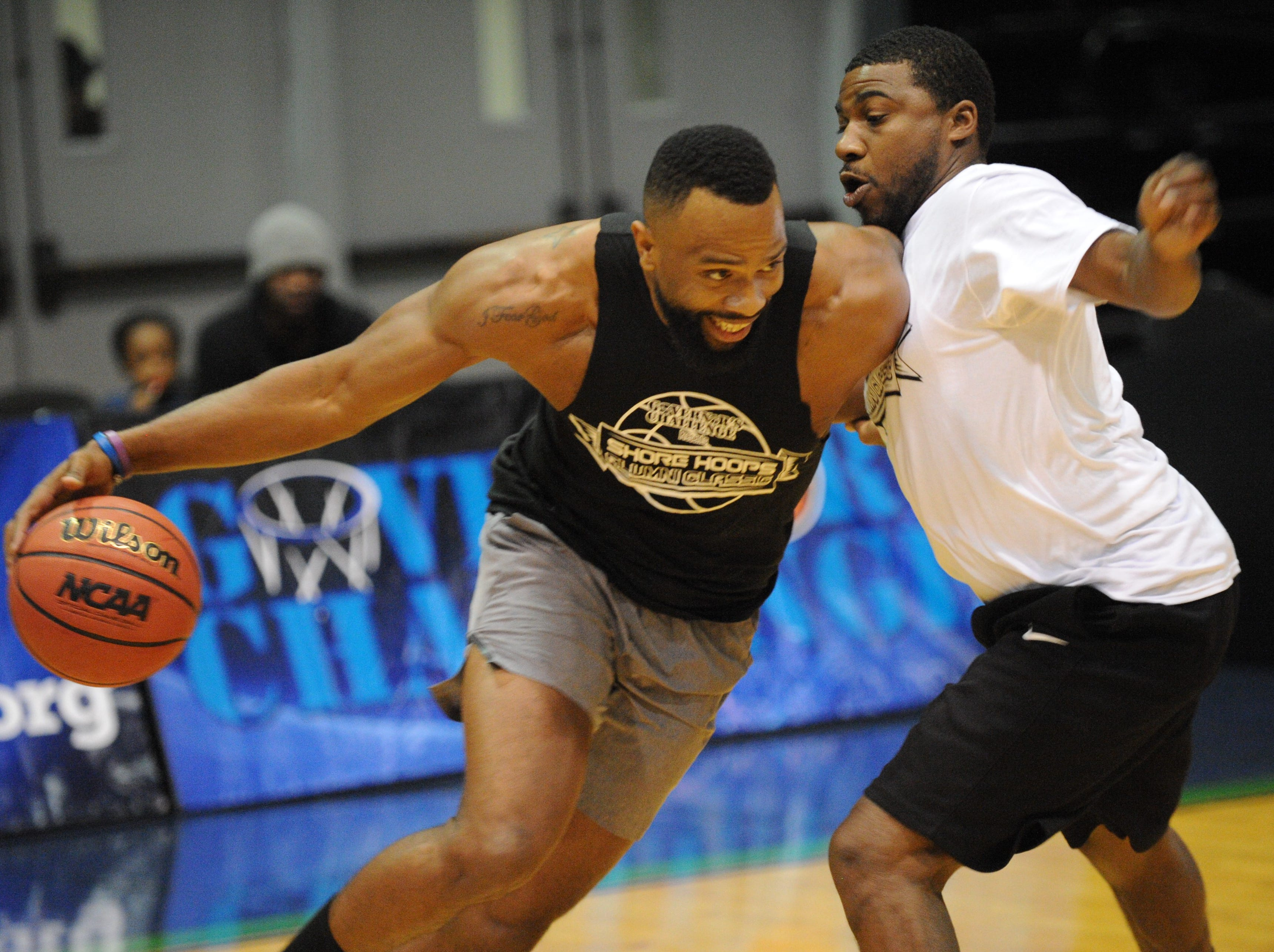 2003 James M. Bennett's John Holmes drives against a defender at the first ever Shore Hoops Alumni Classic on Saturday, Dec. 22, 2018.