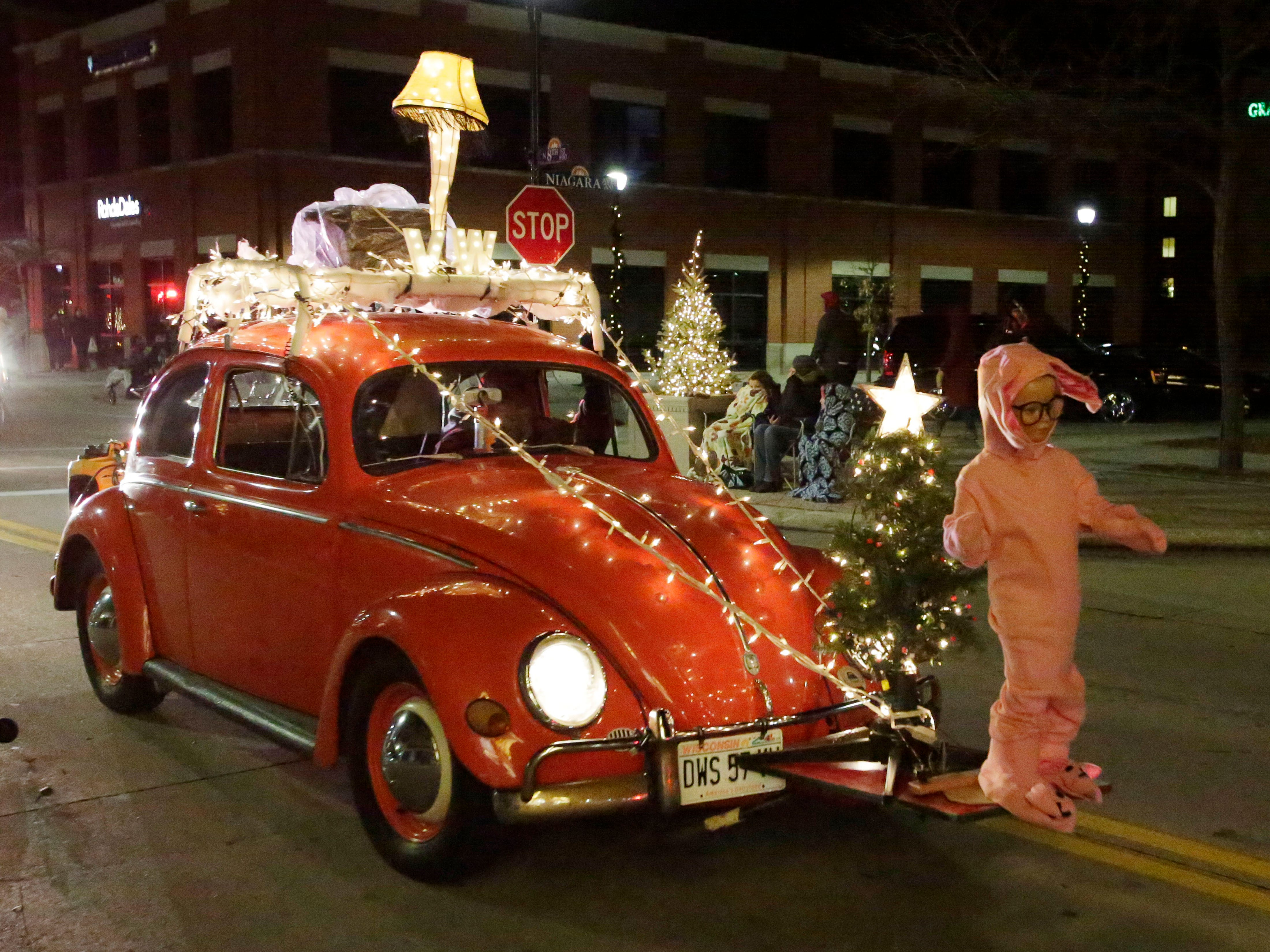 Sheboygan Falls' David Weinhold rolls his Christmas Story themed Volkswagen at the 26th Annual Jaycees Holiday Parade, Sunday, November 25, 2018 in Sheboygan, Wis. His Volkswagen Club of Sheboygan entry came in second place in the non profit division.