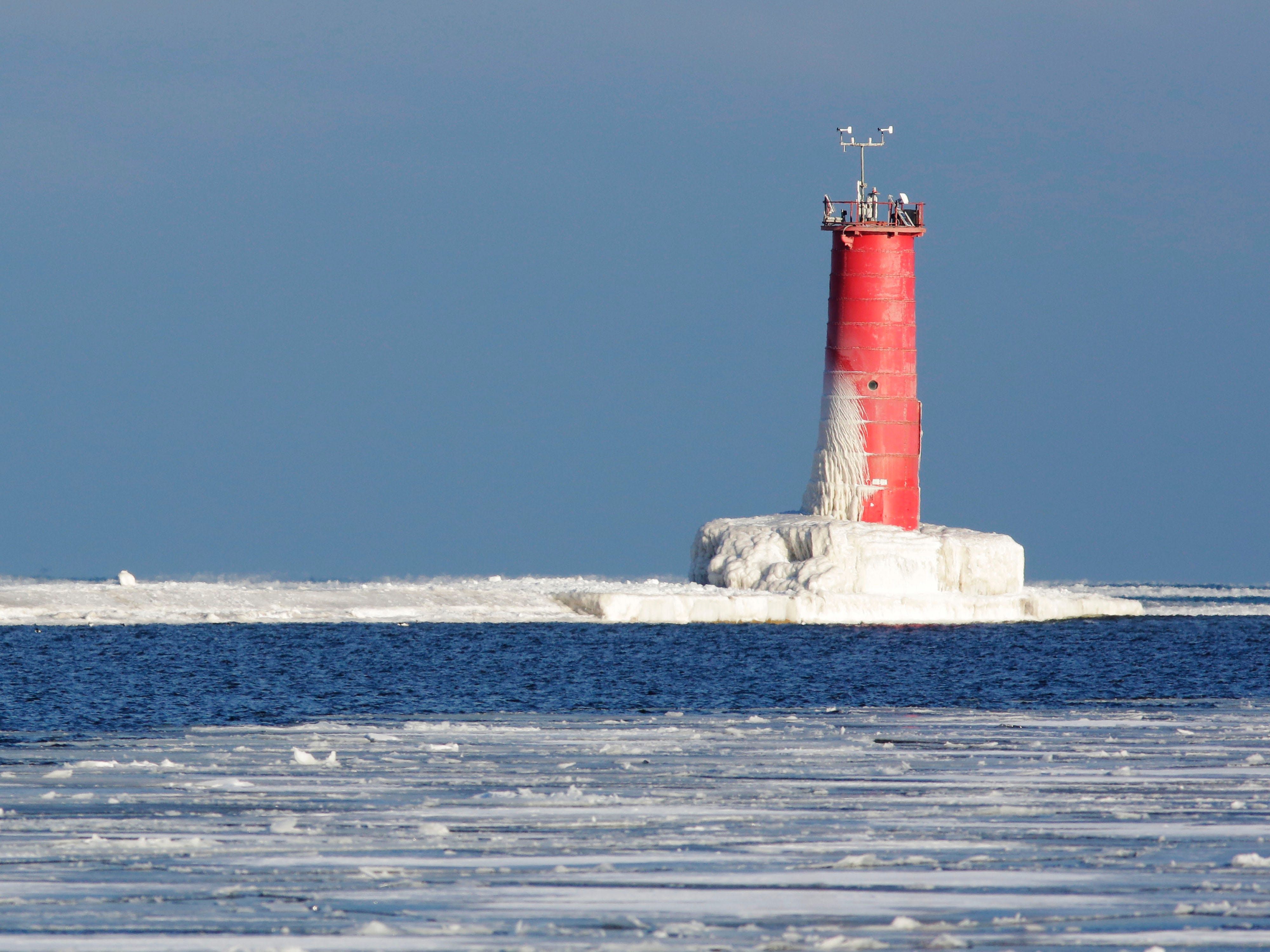 A frozen Sheboygan lighthouse wears a coat of ice, Friday February 9, 2018 in Sheboygan, Wis.