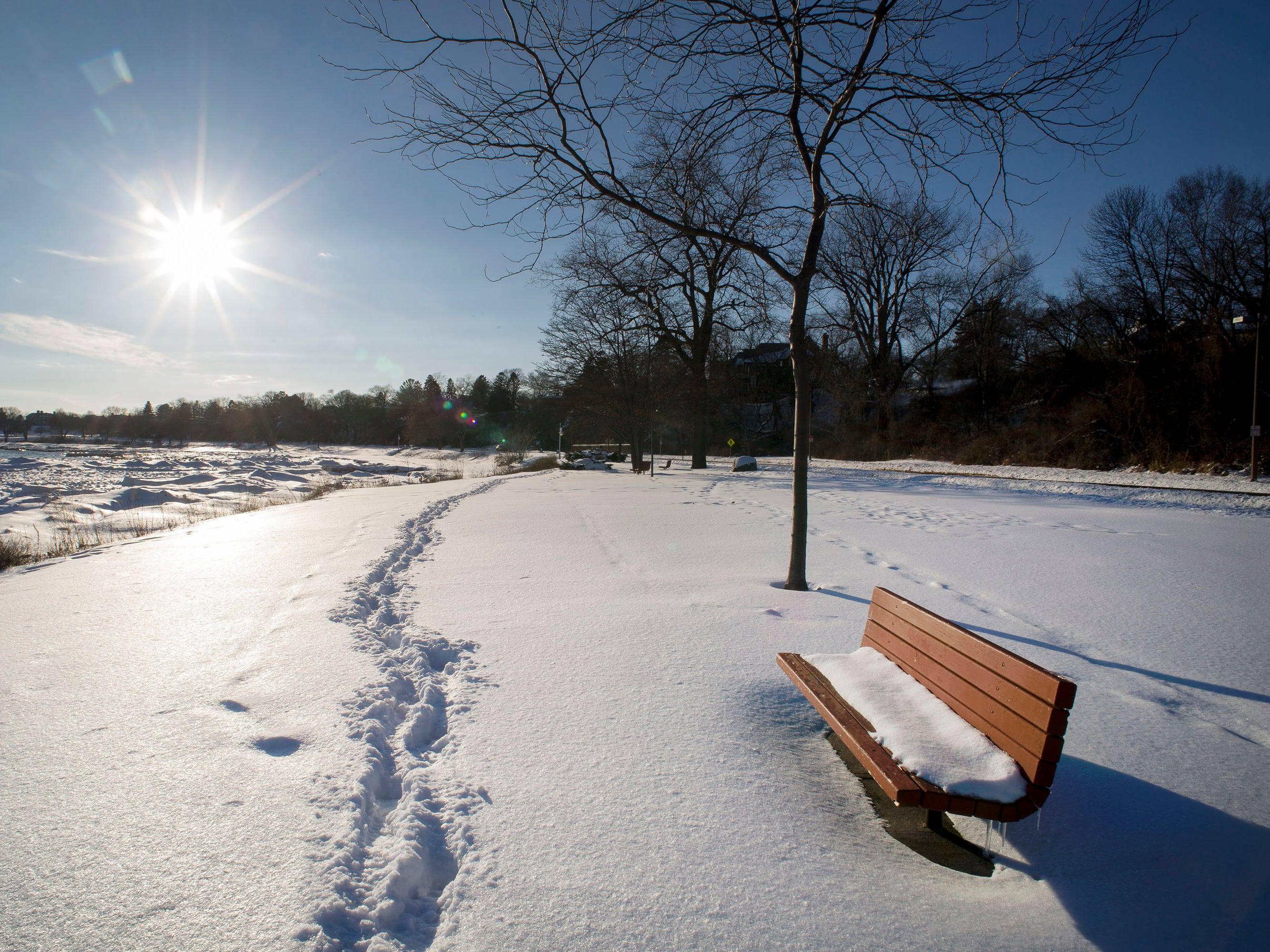 A bright sun contrasts steps in the snow at Deland Park, Friday February 9, 2018 in Sheboygan, Wis.