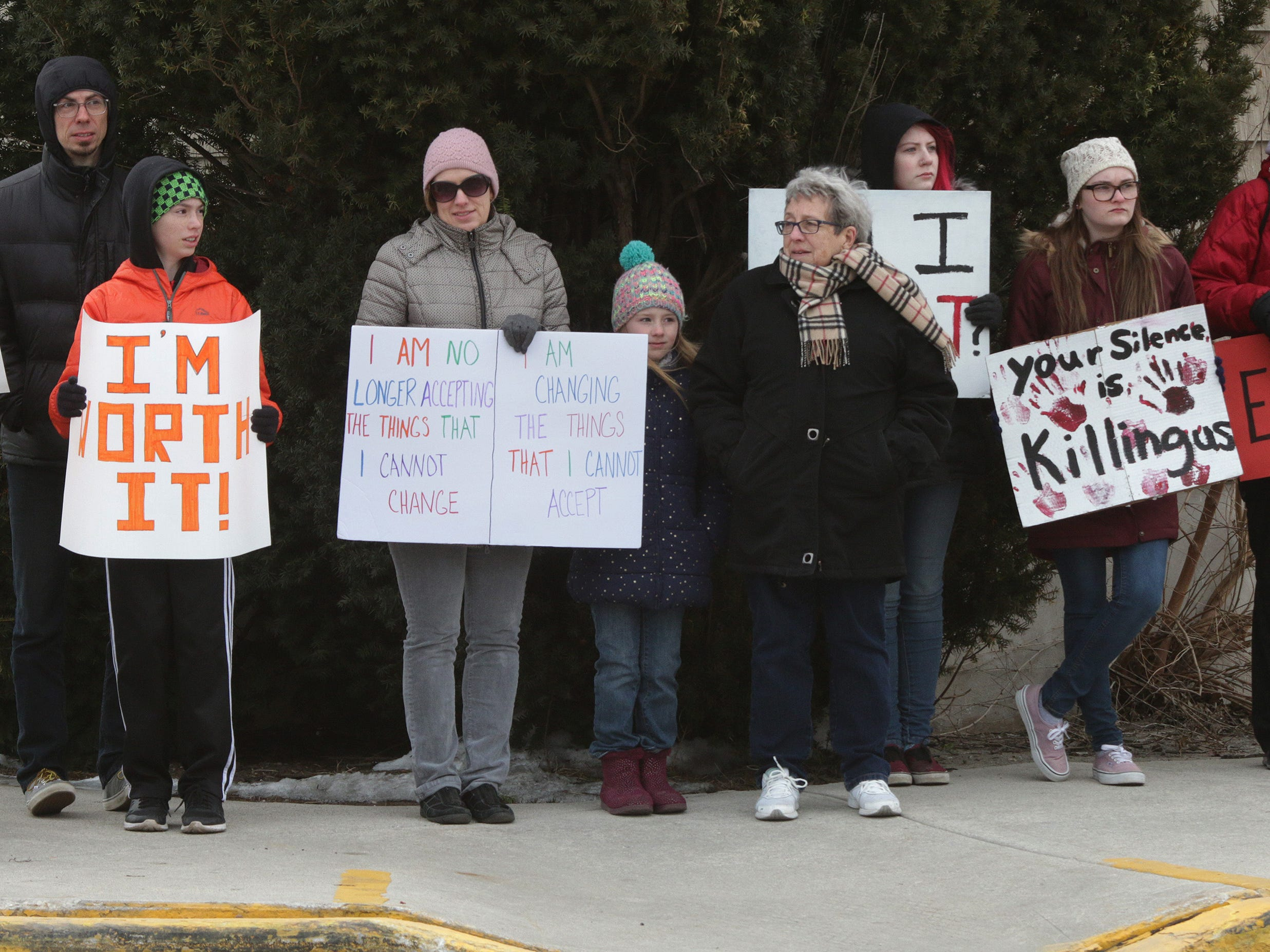 Students and adults participate in the March For Our Lives march, Saturday, March 24, 2018, in Elkhart Lake, Wis.