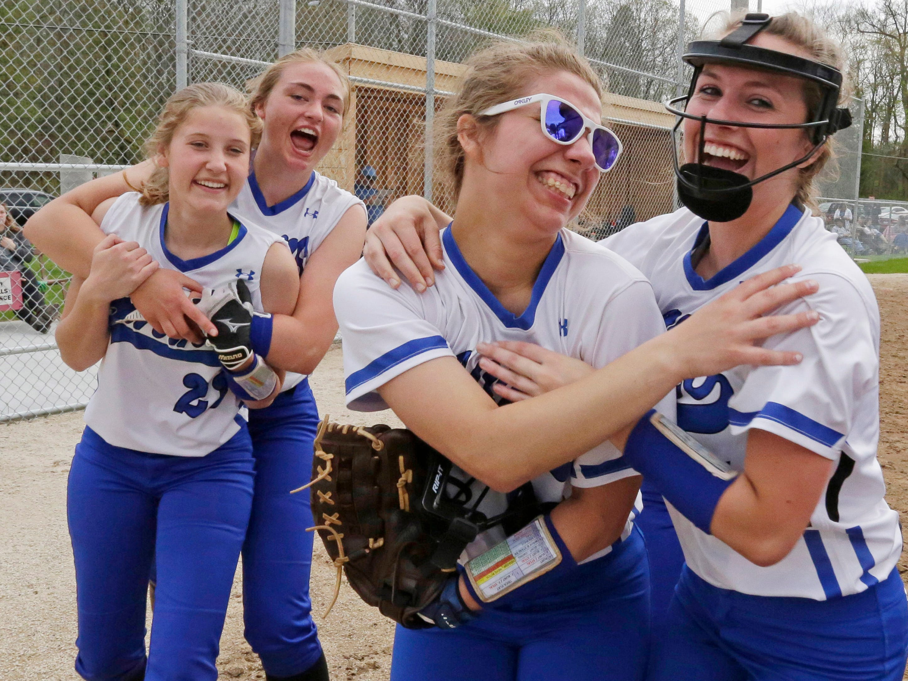 Random Lake softball players celebrate their 6-4 win over Mishicot, Monday, May 14, 2018, in Random Lake, Wis.