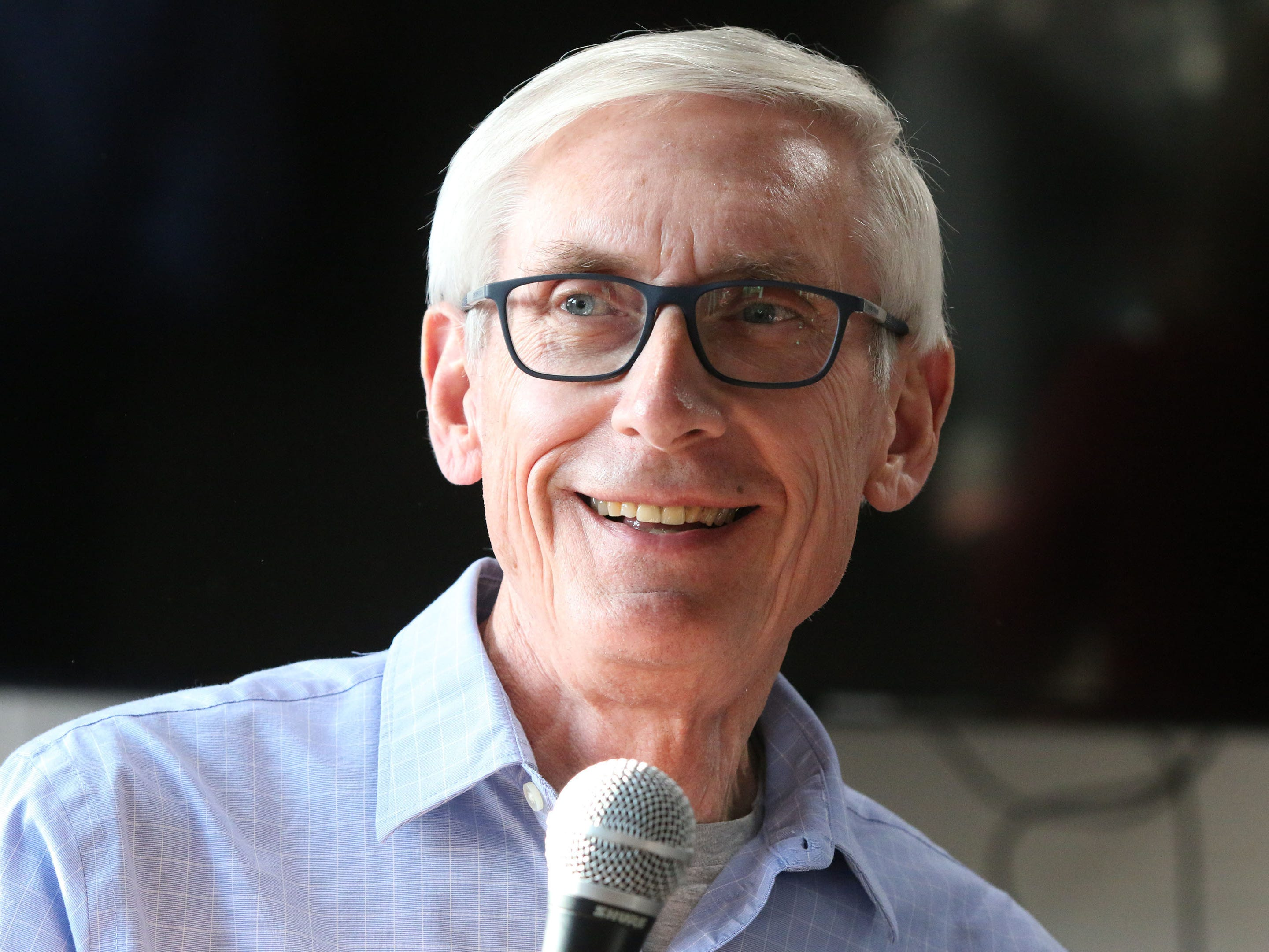 Wisconsin Gubernatorial Candidate Tony Evers and Plymouth, Wis. native smiles at the crowd at The Hub coffee shop, Saturday, November 3, 2018, in Plymouth, Wis. Evers is hoping to unseat Gov. Scott Walker.