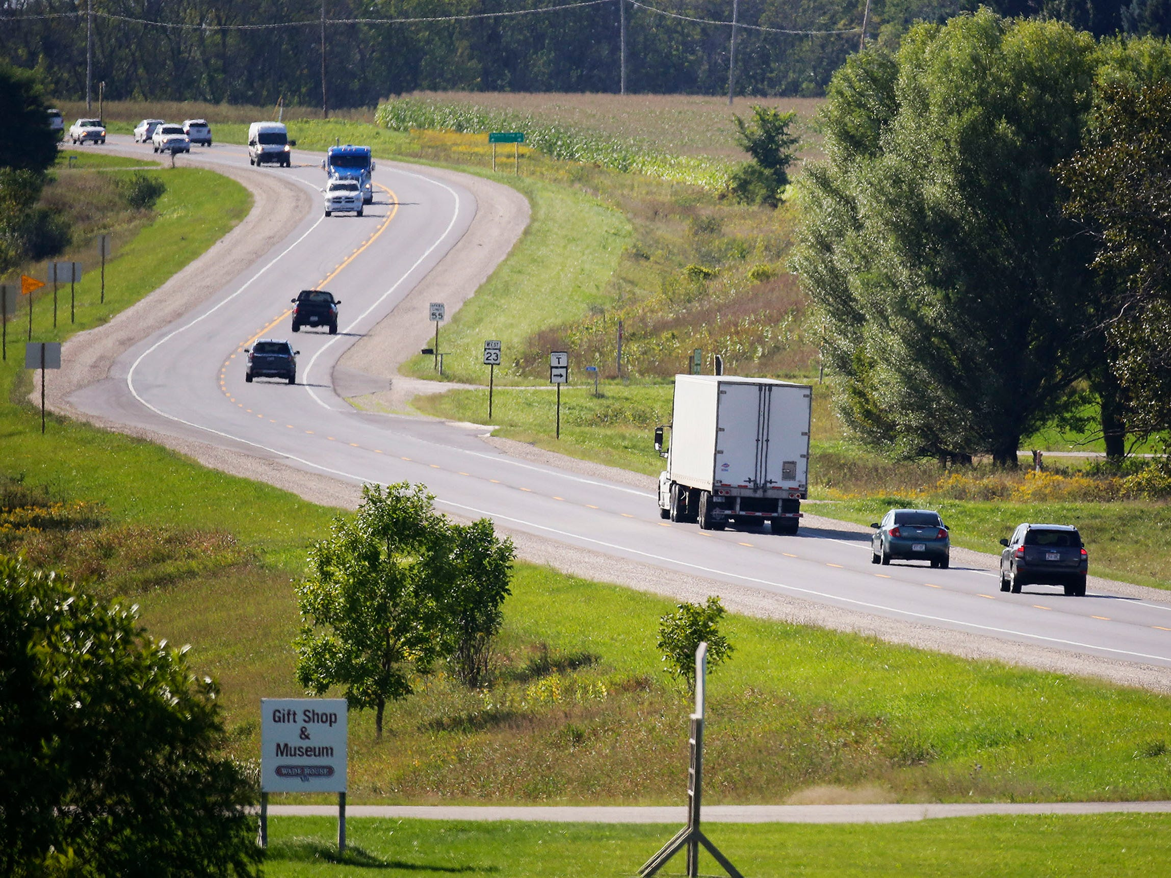 Traffic flows on state Highway 23, Thursday, September 6, 2018, near Greenbush, Wis.  The state is moving ahead with upgrading the road to a four-lane road.