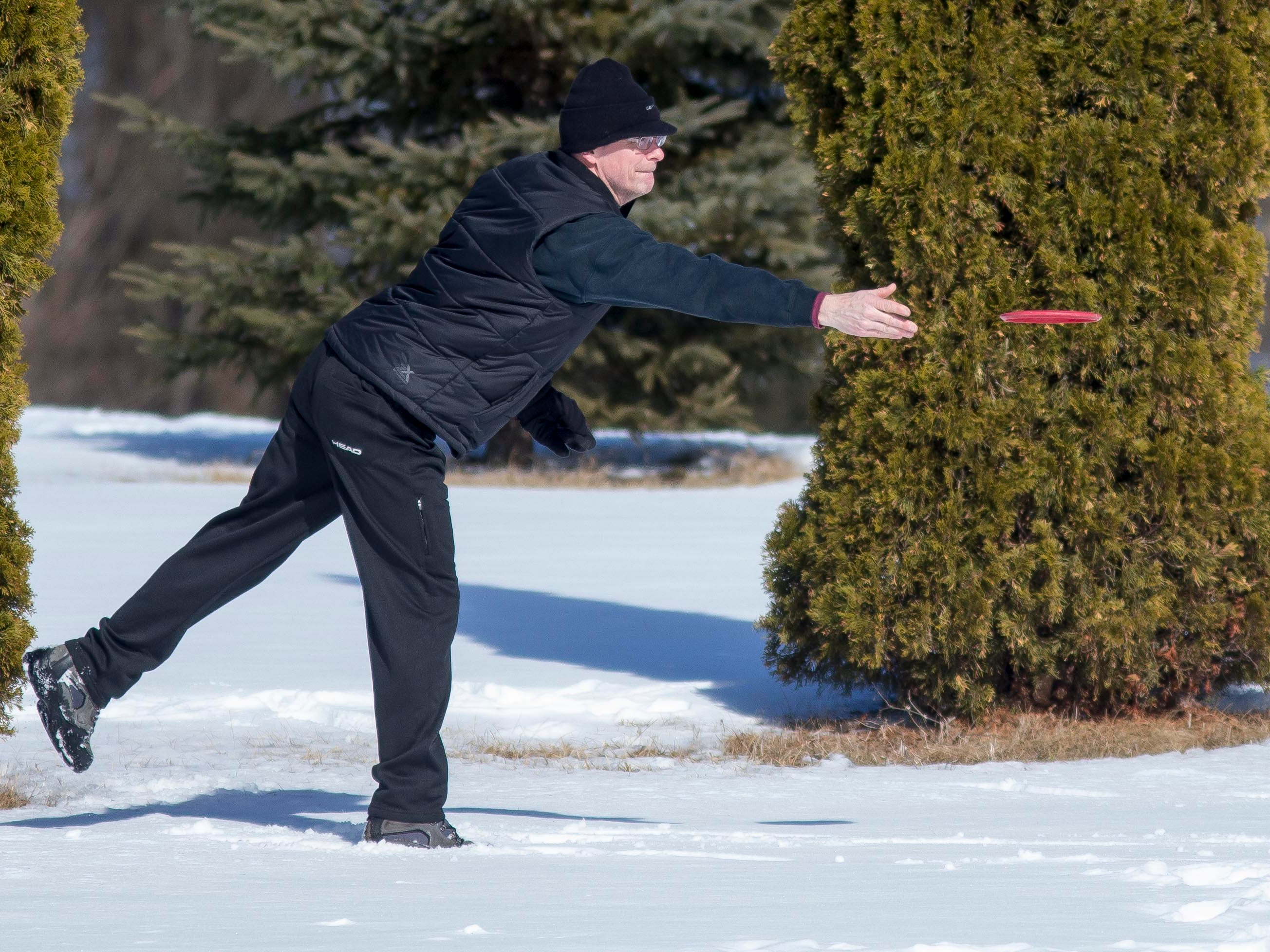 Jim Thielke of Sheboygan throws a disk at Quarry view Park while getting in some disk golf, Friday, March 9, 2018, in Sheboygan, Wis.