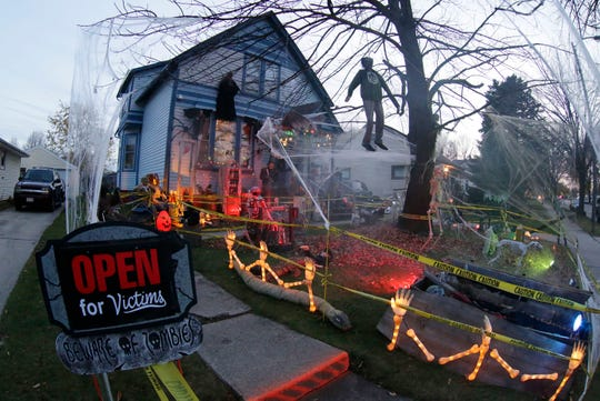 Ron and Jill Thill go all out decorating their home for Trick or Treat, Wednesday, October 31, 2018, in Sheboygan, Wis.